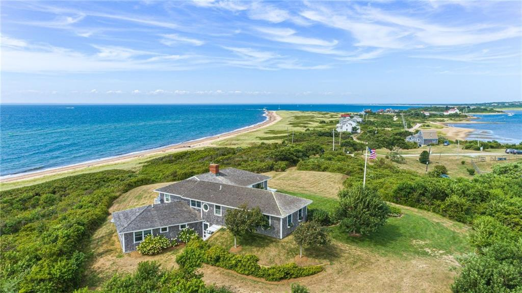 This breathtaking 4.14 acre waterfront property with over 400' of coastline on Block Island Sound sits 34' above sea level.  A rare opportunity to experience coastal living at it's best-Block Island style! Every vantage point on the property provides spectacular views-whether it be gorgeous sunrises, romantic sunsets, boating activity in and out of the Great Salt Pond or star gazing at night, the beauty of the ever changing scenery will wow you.  This home is the definition of an ideal beach getaway-you are just steps to an unspoiled beach for fishing, swimming, beach walking or clamming at Comorant Cove.      This restful beach home has a spacious great room with a cook's kitchen, dining, living room, stone fireplace and sliding doors to two sided deck for outdoor eating and entertaining capturing  the wonderful views.  A lovely master bedroom suite includes a private deck to enjoy the vistas.  A two bedroom wing with full bath completes the main floor.  Lower level features a comfy family room for games and TV watching, separate office/studio and full bath.    Walk the manicured yard and take in the beauty of the established gardens to truly appreciate all the qualities this property has to offerl  A detached two car garage for beach gear, bikes and car adds to the appeal.  Come be captivated by shore birds, spinnakers and magical moments.  By appointment only.