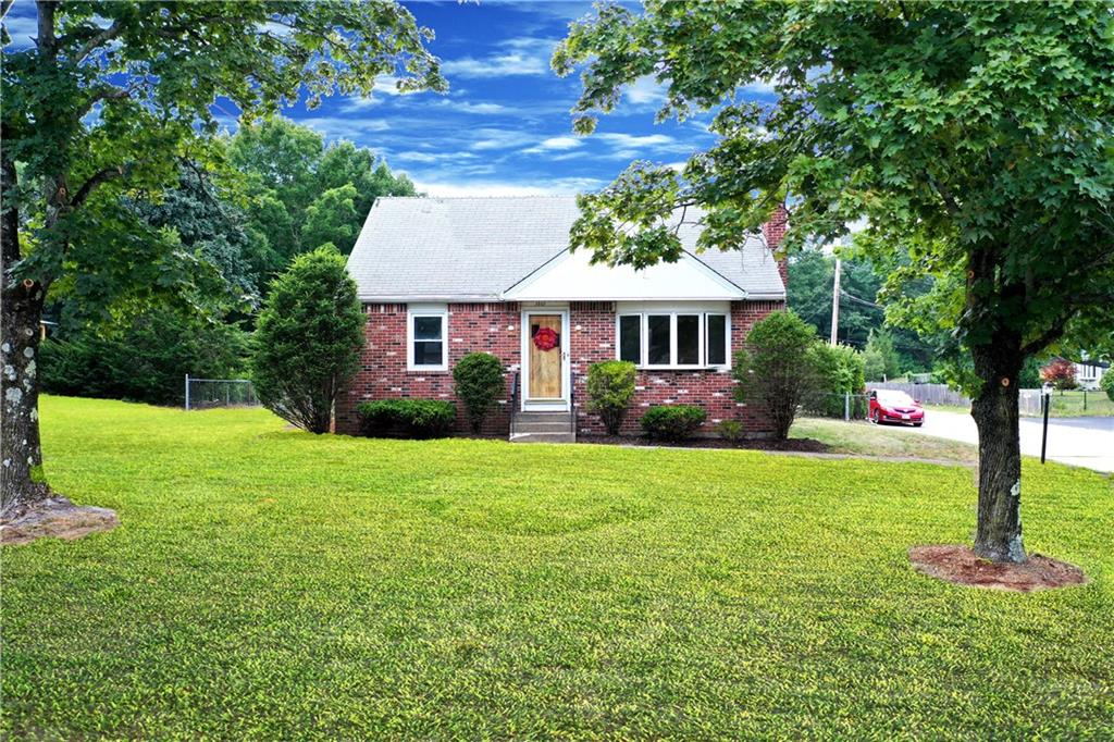 Come on home to this darling Cape in North Smithfield. Don't judge a book by its cover. This is NOT a drive by as it is deceivingly large inside and out! Updated and refurbished throughout. Modern kitchen, fresh paint, redone hardwoods throughout, updated bathrooms, you name it! This home has 4 bedrooms, 1 bathroom, a large living room with wood fireplace, a generous-sized kitchen, updated bathroom, and a breezeway that leads to an attached 1-car garage. Beyond the garage is an enormous yard. After a great cookout, walk through the tunnel in the bushes to an inground pool. (Estimated price to bring it back to its former glory!) Great location in North Smithfield with a great country field (down the street from Wright's Farm!) but still close to anything! This home WILL NOT LAST and is PRICED TO SELL! Book your private tour today!