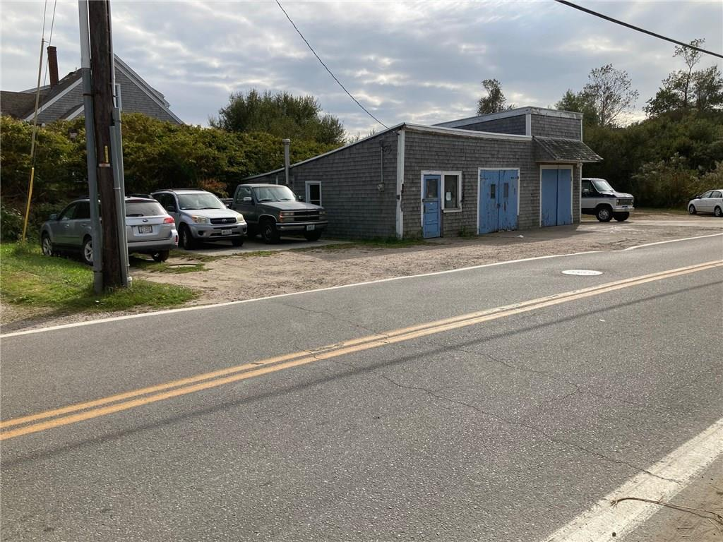 Currently an automotive repair shop.  In Old Harbor Commercial District.  Sewer and Water stubbed in at street but not connected.