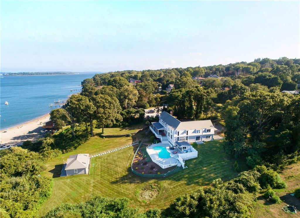 This magnificent coastal residence walks right onto a sandy beach with magnificent water and bridge views.  Watch the boats sail by as you sit on your pool deck.  This home has been substantially renovated including chef's kitchen with Viking appliances, custom cabinets, oversized island all with easy access out to your deck or abutting great room.   Stand alone in-law only steps to the water!  Recently updated electrical, plumbing, heating, insulation, landscaping and more.  This home is located in the wonderful family community of Plum Beach and is perfect for those who enjoy tennis, swimming and sailing.