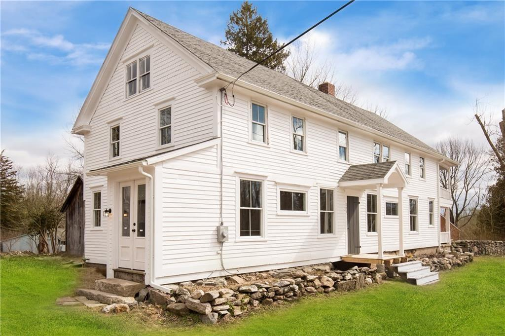 Welcome Home to this beautifully renovated piece of history. This home is truly a gem, offering 4 bedrooms with 2 1/2 baths. This Foster Colonial home, located only a short drive from the Connecticut line, was originally built in 1703. The newly renovated custom, light-filled kitchen provides ample storage space including a large center island with cabinetry all around. This custom cabinetry boast under cabinet lighting, 3-inch crown molding, soft-closed doors and drawers and open-aired shelving. The kitchen is open to the dining room with original clapboard siding that extends out to a brick-lined screened-in porch. With wide plank wood floors, a brick fireplace with original molding, built in original shelving, multiple covered porches and 3 large outbuildings throughout the home. The 4 bedrooms and 2 1/2 baths also include wide plank flooring, original exposed beams and brand new bathroom fixtures including a claw-foot tub and first floor laundry room. Theover-sized master bedroom includes a separate walk-in closet/dressing room that connects to the master bath with closet space, double vanity, and subway tiled shower. To round this beautiful home out, some of the amenities include; newer roof, brand new farm-style windows, newer septic and well, 200 amps electrical service, 2 heating systems with central AC supplying the whole house and an extended walk up attic. Don't miss out, call today to get your piece of Foster history.
