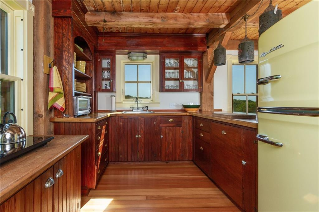 Guest House Master Bedroom - Balcony with Views of the Atlantic Ocean - Fir Floors - Marvin Hurricane impact Windows
