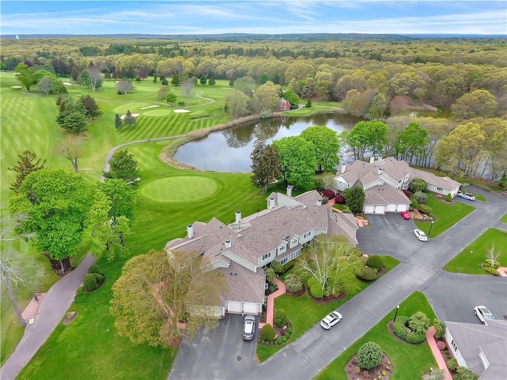 Pride of ownership in this Luxury Condo at Quidnessett Country Club with unrestricted fresh, pond water views and the golf course. This 2 story home is over 3000 square feet and features 2 bedrooms, living room with vaulted ceilings, 2-way fireplace, 2-car garage, large laundry room and extended porch /balconies overlooking the course. Recent upgrades include granite countertops throughout the home, new kitchen cabinets, wet bar and new central Air Conditioning mechanicals... there is also a potential for an elevator to 2nd story. Simplify your life and enjoy the Condo Life at Quidnessett. Please ask me about membership opportunities to the club. This middle unit offers privacy, and with great views of the course and is a must see.