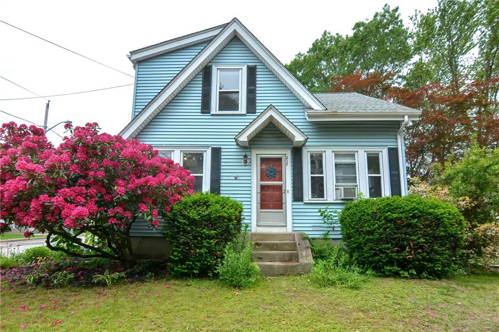 This charming 3 bedroom colonial sits on the corner of a quiet street with desirable features. The first floor of the home boasts hardwood flooring throughout the living space, a sun drenched living room that opens to the dining room, and a large kitchen with a plethora of cabinetry. There is a mud room/drop zone, a newer half bath, and a 3 season side entry porch that completes the first floor. Upstairs you will find 3 well appointed bedrooms with hardwood flooring, and a full bathroom. Additional specs includes a detached garage, raised garden beds and beautiful perennial flowers, Myron Francis school district, vinyl siding, built in work bench in the basement, with a plethora of storage, repainted interior, and convenient location to area amenities and highways.