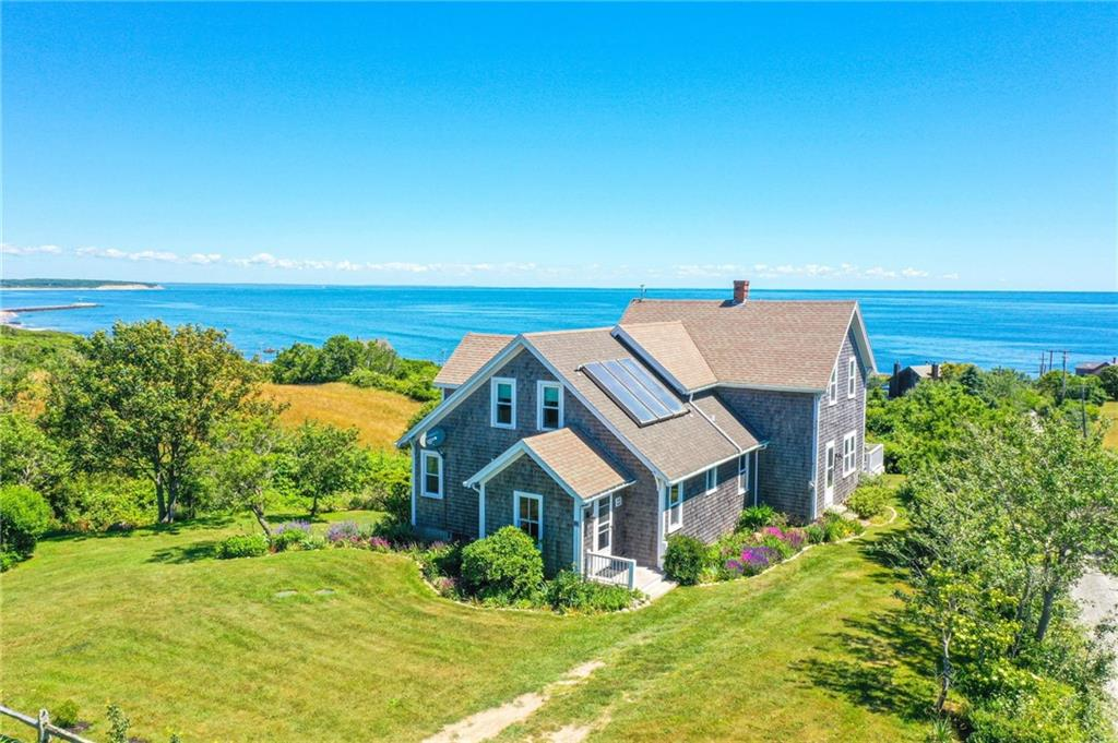 273 New haven House Road Classic Block island farmhouse with stunning Atlantic Ocean views!  Perched on a beautiful knoll just off Spring Street, this charming home offers panoramic ocean and island views just a short distance from Town.  With over 2000 square feet of living space, this year round home boasts four bedrooms and two baths with interesting nooks and crannies as well as over 700 square feet of decking. From sunrise to moon rise the views will entrance you!  A full basement with an integrated garage and a separate, detached shed provide great storage areas.  An adjacent, conserved lot adds significantly to the sense of privacy and protection.  Originally constructed in 1889, updates and excellent owner maintenance over the decades have resulted in a home that is ready for your occupancy and personal touch.  A wonderful place for your family's Block Island memories to begin!