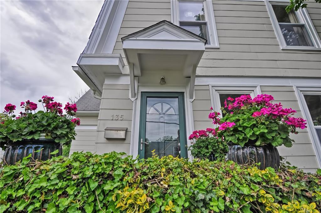 This spacious and charming Colonial is now being offered in the heart of Riverside. Over 1,700 square feet of living space and there are beautiful original details throughout. The first floor features a bright and open floor plan with high ceilings and detailed woodwork, including ¾ height wainscoting, coffered ceilings and custom built-in cabinetry. Also on the first floor is a fully applianced kitchen with island, heated sunroom with new flooring, beautiful large dining room, family room, den, and half bath. The second floor boasts three beds and an updated full bath with a granite counter and new vanity. Large home with generous room sizes all in a convenient location. The East Bay bike path is one block away and only minutes from highway access, shopping, nearby hospitals, and several parks within walking distance. OFFER DEADLINE SUNDAY 7/11 AT 10AM.