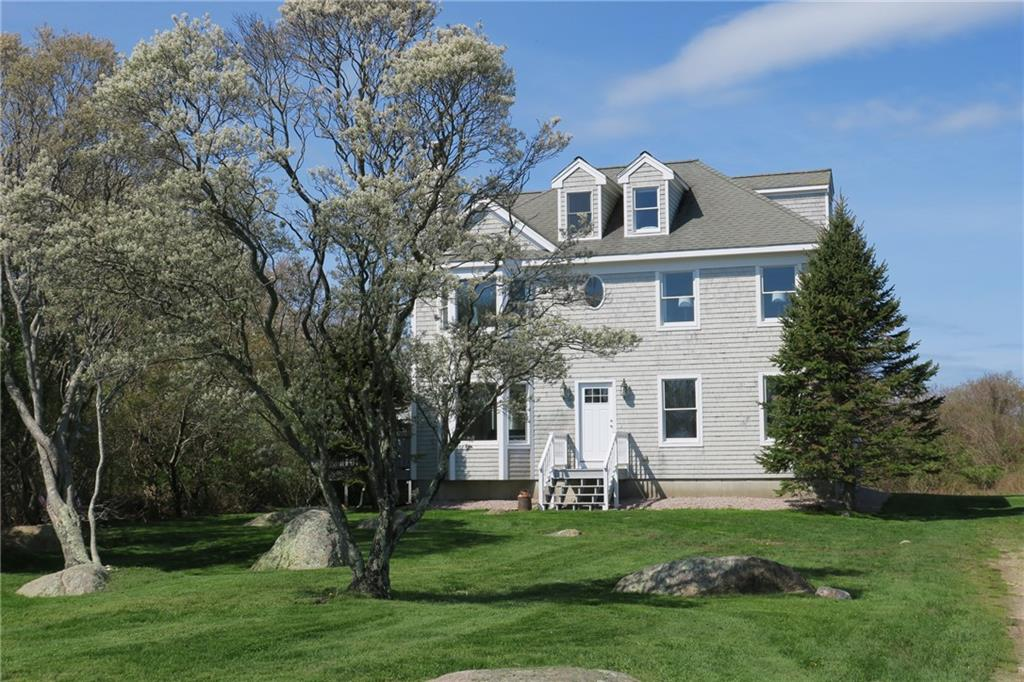 1646 Payne Road Located near Sands Pond, this recently renovated, winterized home is part of the Sands Pond Homeowners Association.  The home is situated on slightly less than an acre of land, but the neighborhood enjoys common, Association owned  open space as well as the beauty of abutting significant acres of conserved land and nature trails.  The kitchen and baths have been recently updated and  new hardwood flooring has been installed throughout most of the home.  The open living/dining/kitchen area includes a wood burning fireplace and access to lovely decks.  The house boasts three bedrooms, including a lovely master bedroom suite, and the top floor of the house is the perfect hang out space for kids.  A family room, plus an office provide ample room for all family members to pursue hobbies, watch movies or work remotely. It's an easy jaunt to town  or Mohegan Bluffs from the property--centrally located--but far away enough to enjoy the peace and serenity of the island.