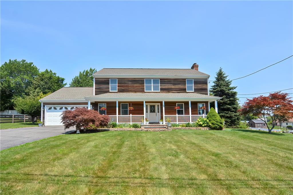 Here is your chance to move into this spacious custom built colonial that has been lovingly cared for by its original owners! This 2500 sqft home offers 4BD/2.5BA, a two car garage and much more. Generous sized rooms featuring a stone fireplace in the living room with double sliders to the back deck that can be accessed through the living room and dining room. Stainless steel appliances with gas cooking in the kitchen with lots of counter space and cabinets. Off of the kitchen you have another living room that would also be great as a home office. Past the kitchen and down the hall to the two car garage is a half bath with laundry. On the second floor you have the master bedroom with walk in closet and and full bath in addition to a full bath and three bedrooms with large closets. Additional storage above the garage can be easily accessed through one of the bedroom closets along with more storage in the attic. This home gets a nice breeze from Mount Hope Bay but if central air is preferred, the air ductwork has been completed and is ready for HVAC to be connected. Located in a nice, quiet neighborhood with nearby waterfront dining, attractions and amenities.