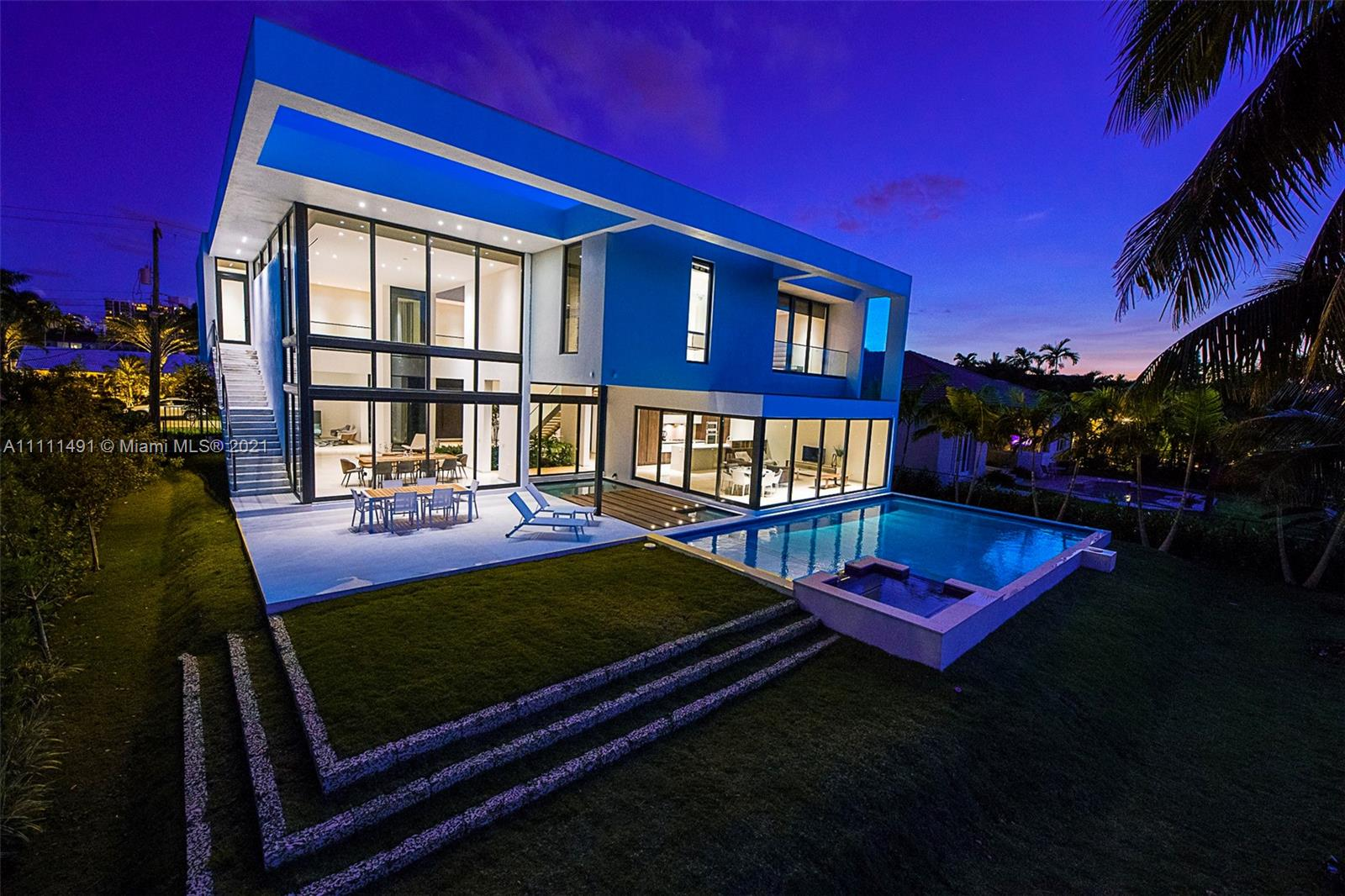 Located in the exclusive Golden Isles community, this architecturally stunning waterfront home displays exquisite sophistication, & thoughtful details throughout. This Modern home seamlessly combines traditional w/ a modern twist creating a balance that boasts comfort, light, & warmth. Offering 6 bedrooms, unique custom baths, study 2 den, private maid quarters, laundry rooms, & more!