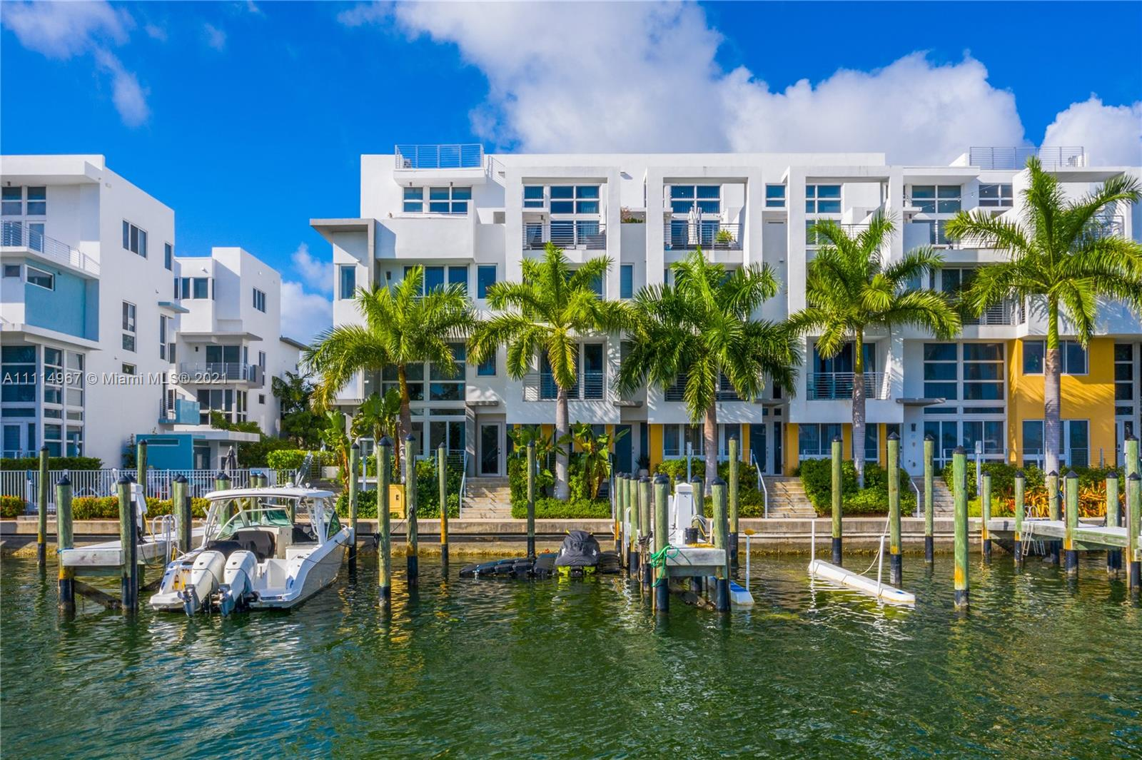 Live the Miami dream in this beautiful 4 story waterfront townhouse. Located in Iris On The Bay featuring 4 bedrooms with private balconies, 4.5 bathrooms, private elevator, modern European kitchen, laundry room, rooftop terrace with outdoor kitchen, and spacious 2 car garage. Water access is only within a few steps from your door for all your boating and water sports needs. The bedrooms are well laid out and split with the master suite on the 4th floor. The private elevator provides amazing convenience for all floors within the home. The property is located a few blocks from beach, across from normandy golf course, tennis courts, children's playground, soccer field, restaurants, and shopping.