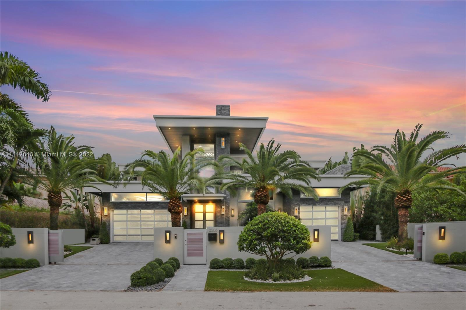 Exquisite modern estate built in 2016 on an oversized lot with 80'feet of deep water frontage. Take a sunset cruise into the Intracoastal waterway directly from your backyard where you are walking through a majestic waterfall resort style pool/terrace with full outdoor summer kitchen.  All concrete and steel construction. Smart home features Lutron system, cameras, sound system, alarm and intercom throughout the home.  Captivating grand kitchen island, top of the line Subzero and Wolf appliances. Elevator, several wine coolers, stunning office with clear see through windows to showcase your extraordinary car collection, second floor loft, 2 laundry rooms and grand 2nd floor terrace over looking the canal. Accent lighting throughout. Fantastic Las Olas Seven Isles location.