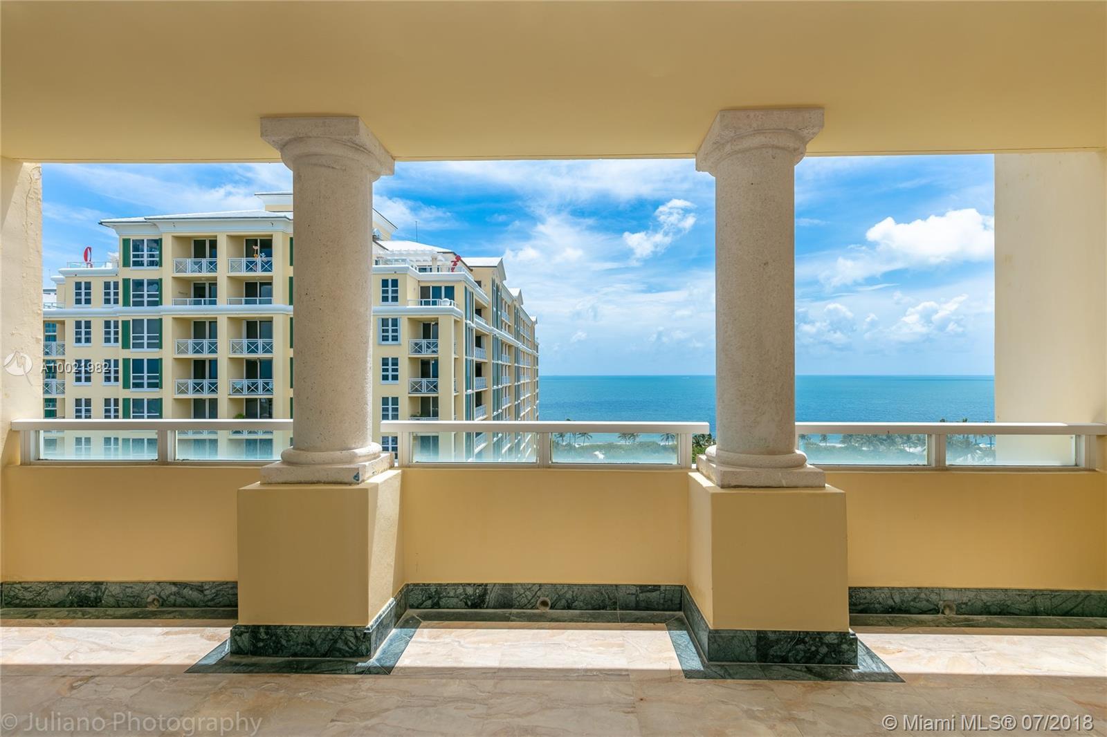 Elegant beachfront, corner unit in Key Biscayne, with spacious terrace (ocean, bay, city views).