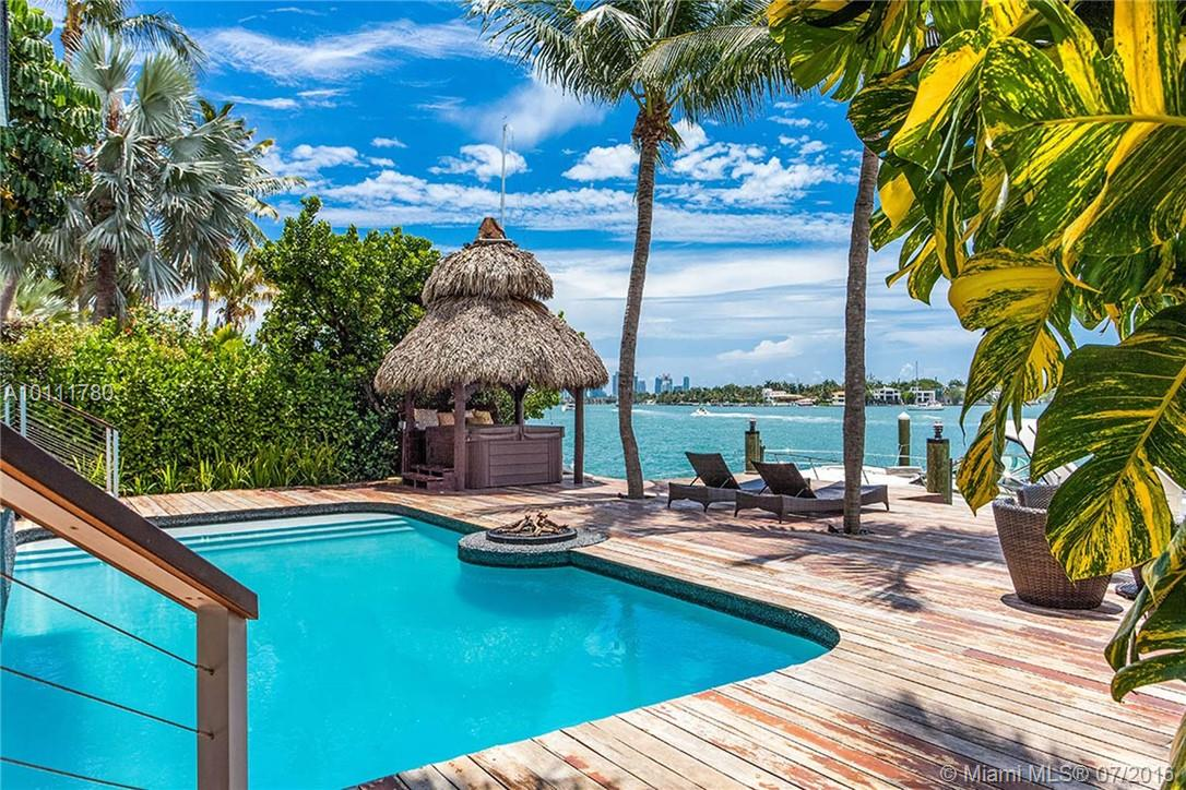 Magnificent Balinese-style 5 BD/6 BA waterfront home on Venetian Islands w/ 60ft of water frontage, pool & expansive rooftop deck. Soaring ceilings over great room, large bay windows for natural light, Bangkirai wood details, chef's kitchen, entertainment room w/ pool table and marble-topped bar w/lighting features. Master suite w/ water view, lush landscaping for privacy, poolside fire pit & hot tub, outdoor dining & basketball court. Desired wide bay & downtown views. $50,000 FOR ANNUAL RENTAL ONLY.