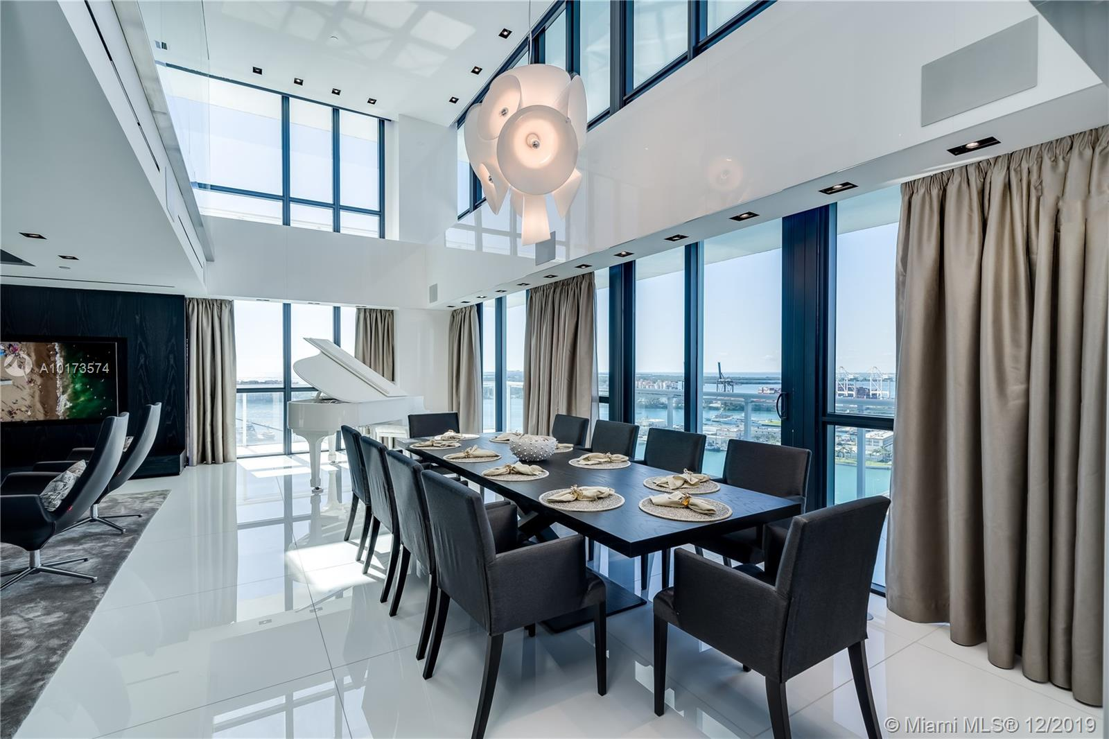 TOTALLY RENOVATED ONE OF THE KIND TWO STORY PENTHOUSE WITH SKYLINE MIAMI, STAR ISLAND AND OCEAN VIEWS. CUSTOM GLASS STAIRS, WET BAR, WINE ROOM, FOUR BEDROOMS WITH WALKING CLOSETS, POWDER ROOM AND OFFICE WITH FULLY INTEGRATED CRESTRON AND LUTRON SYSTEMS. MIELE AND SUBZERO APPLIANCES.