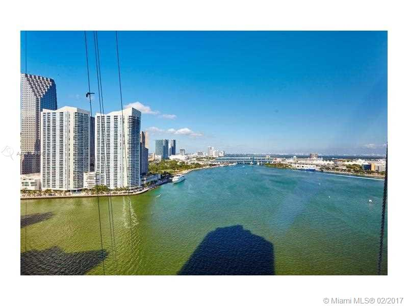 Stunningly renovated gem in exclusive and luxurious Three Tequesta point.  Enjoy unbelievably breathtaking views from this spacious residence in the sky overlooking Biscayne Bay, Miami Beach, Port of Miami, Miami downtown skyline. Both day and night views are phenomenal.  Beautiful attention to detail throghout the recent renovation. Brickell Key is an exclusive island community with 5 star amenities. Unit comes with 2 parking spots and one storage space. Show with pride.