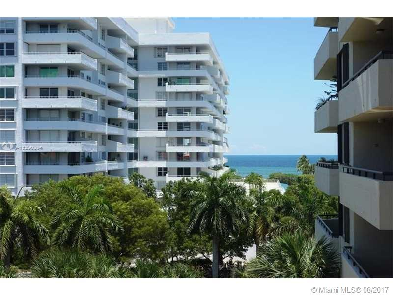 LARGE BRIGHT 2/2 CORNER UNIT WITH A GREAT VIEW OF THE OCEAN AND STATE PARK, PRIVATE BALCONY. THE KITCHEN IS COMPLETELY REMODELED WITH ALL NEW APPLIANCES AND GRANITE COUNTERTOPS. MARBLE FLOORS THROUGH OUT THE LIVING AREA, PLUSH NEW CARPET IN THE BEDROOMS, CUSTOM CLOSETS. UNIT HAS 2 ASSIGNED COVERED PARKING SPACES !  WASHER AND DRYER IN THE UNIT, AND EXTRA STORAGE. AMAZING CLOSET SPACE. COMPLEX HAS 24 HR GUARD AT THE LOBBY, POOL, SPA, GYM, STEPS TO THE BEACH, AND MORE. ISLAND LIVING AT IT'S BEST. TENANT OCCUPIED UNIT 8/31/20