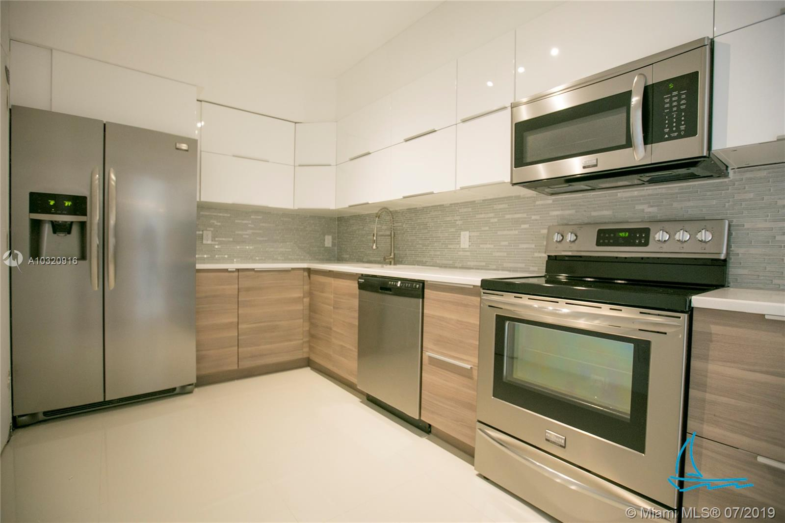 Beautiful and completely updated 1 bedroom, 1.5 bath condo in Bay Harbor Islands! Large 24' white porcelain floors throughout, newer kitchen and bathrooms, new lighting, and more! Condo unit has an open floor plan with huge living room. Spacious kitchen with white cabinets and stainless steel appliances. Large bedroom has an en suite bathroom with double sink and walk-in closet. Building is along the canal and features BBQ area, pool overlooking the water with beautiful views, party room and more! Close to Bal Harbour shops, beaches, restaurants, grocery stores, and more! A must see.