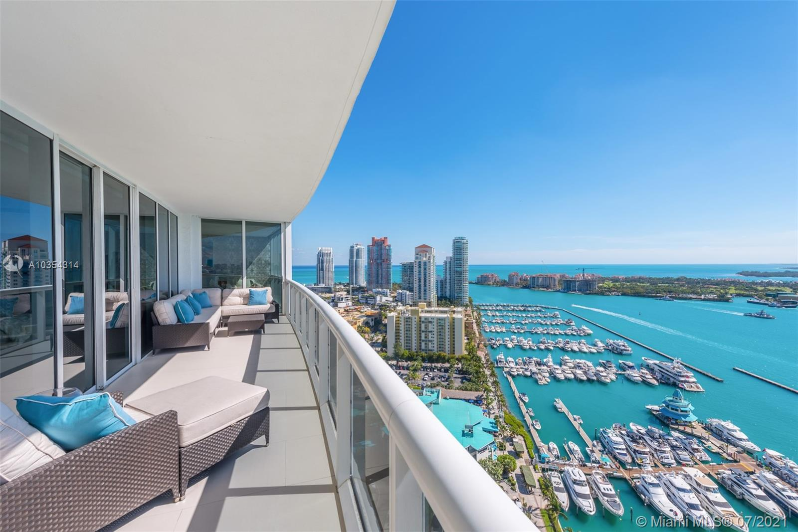 Enjoy ultimate luxury living in this stunning contemporary unit at the exclusive Murano Grande in South Beach. A private elevator foyer opens to a beautiful flow-through floorplan offering breathtaking views from floor to ceiling windows of the ocean, Fisher Island, Downtown Miami and Biscayne Bay. This spectacular unit offers luxurious custom finishes throughout, 3 bedrooms, 3 full bathrooms and 1 half bathroom, Legrand lighting system, automatic curtains, 2 expansive balconies, walk-in closets, a wet bar with hidden built-in storage &white tile flooring throughout. The kitchen features a Sub Zero fridge, wine cooler & Miele appliances. With balcony access and stunning views from every room the master bedroom offers a large master his/hers walk-in closets, tub and a large rainfall shower.