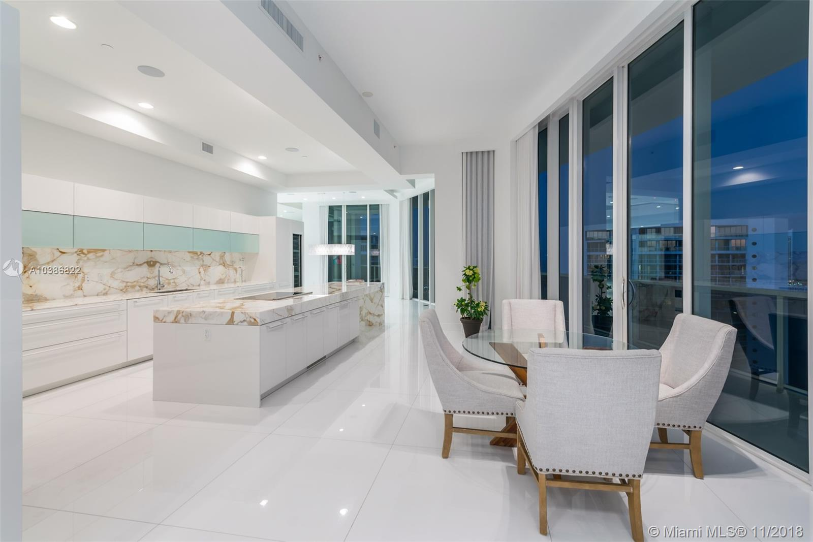Bellini Williams Island Southeast Corner Penthouse! Breathtaking panoramic water views through 12' floor-to-ceiling windows greet you as you enter through your private foyer. Former developer model 4,955 SF unit offers the ultimate in luxurious upgrades, open floor plan & custom gourmet kitchen designed by world celebrated Chef Erik Ripert. This 4BD, 6 full & 1 half BA unit also features an expansive master suite, his/hers master bathrooms, top-of-the-line appliances, marble countertops coffee and espresso maker, island seating & wine storage unit. Wraparound balconies offer unobstructed 180-degree water views of the intracoastal & Atlantic Ocean. The Williams Island lifestyle offers 5 star amens: 27,000 sq ft gym & spa, island club, 16 tennis courts, private marina, & restaurant.