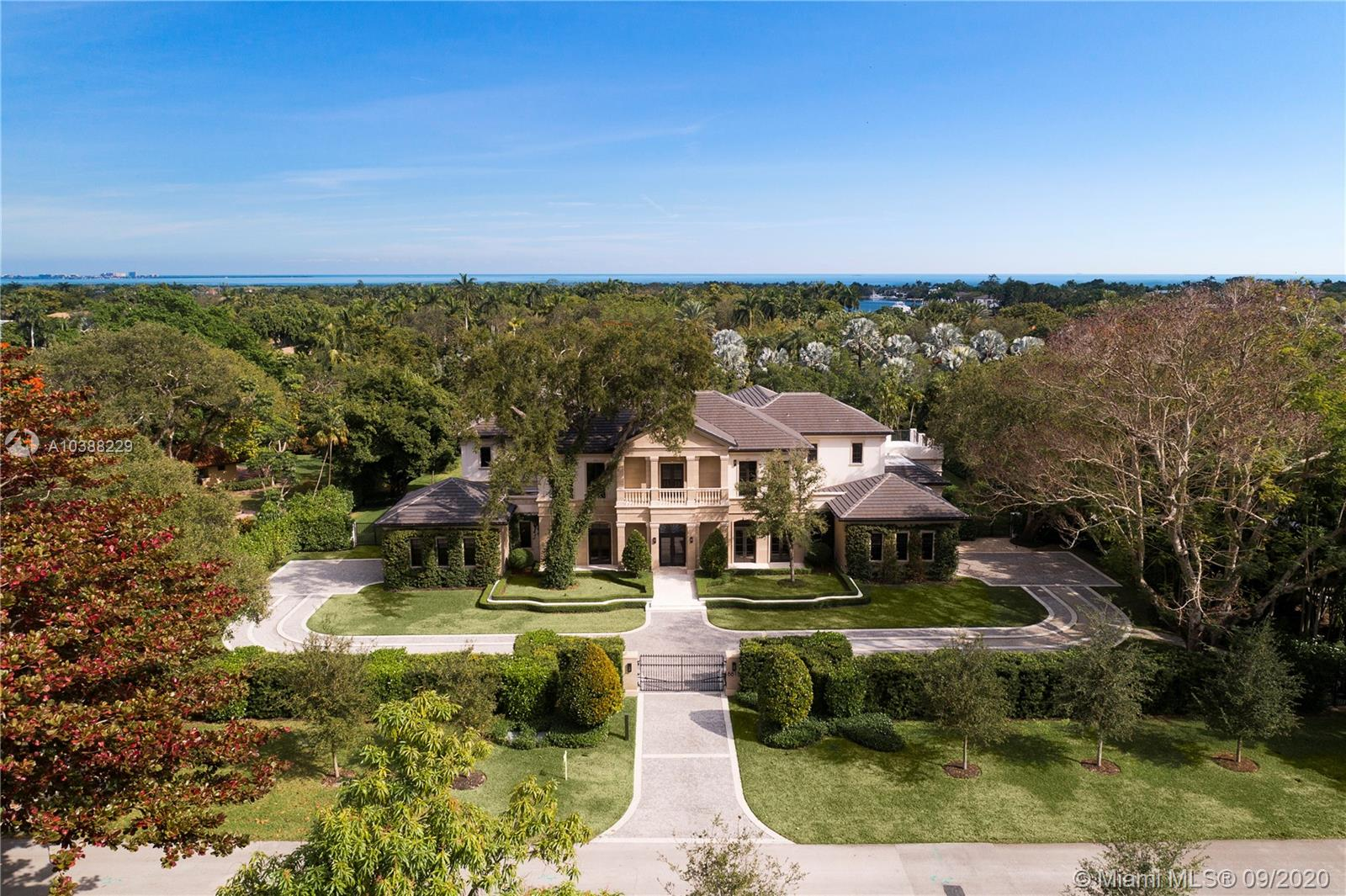 Set perfectly on a 50,000sf waterfront lot in prestigious and gated Gables Estates, this 2017 classic Palladian home offers the perfect backdrop for either lavish entertaining or cozy family affairs.In the 12,839 sf home, one finds a theater, large family room,gourmet cook's, eat-in kitchen, and master suite with his and her lavish baths and dressing room closets; 4 car garage, covered terraces with a cabana, summer kitchen and sparkling, oversized pool, serve as the centerpiece of the rolling back lawn.