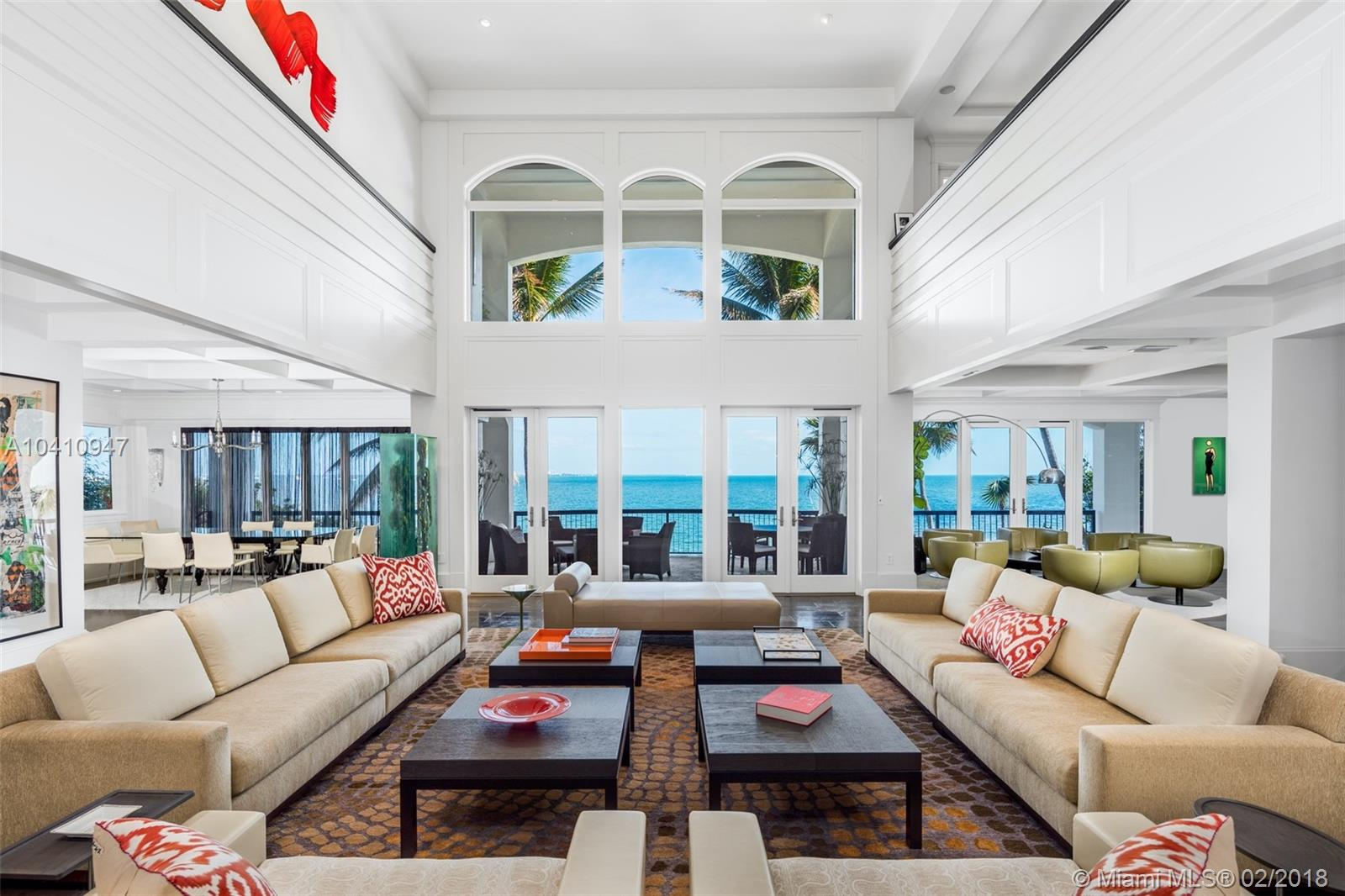 Enjoy living in this contemporary masterpiece located in coveted guard gated Four Way Lodge Estates on the wide-open bay in Coconut Grove. No expense spared in this 5BD/5.3BA 13,101 Total SF estate,offering 97 Ft of WF with unobstructed panoramic views. This private residence exemplifies indoor/outdoor living at its finest, featuring surround sound system, home gym, media room, hurricane impact windows & boat lift/dock. State-of the-art chef's kitchen boasts top of the line appliances, gas cooktop, & an outdoor herb garden.Take in stunning bay views throughout your very own tropical oasis & relax in your spacious master suite,complete w/spa-like bath. Entertain by the pool in your luscious backyard & dine al-fresco on the expansive covered patio,complete w/outside kitchenette, BBQ & bar