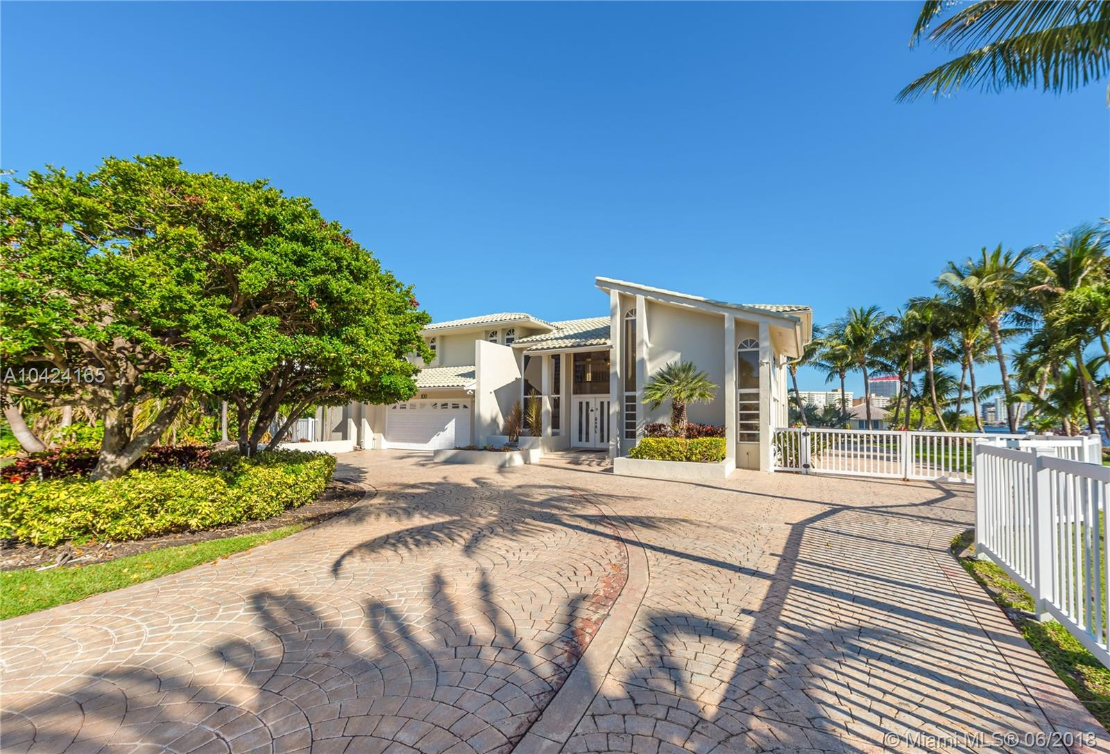 JUST LISTED!----Unique, Breathtaking intracoastal point property with ocean access and 300 feet of well kept seawall. This almost 1/2 acre, four bedroom, three bath, two story home sits at the street on a quiet cul de sac with magnificent views abounding from every room. One of the larges lots (20,000 sq. ft.)  in upscale, guard gated, Golden Isles! The Community is complete with tennis courts, private park and children's playground, 5 minute access to all beaches, shopping, nightlife, Malls and Gulfstream Park and Casino. Close to both Fort Lauderdale Airport and Miami Airport.