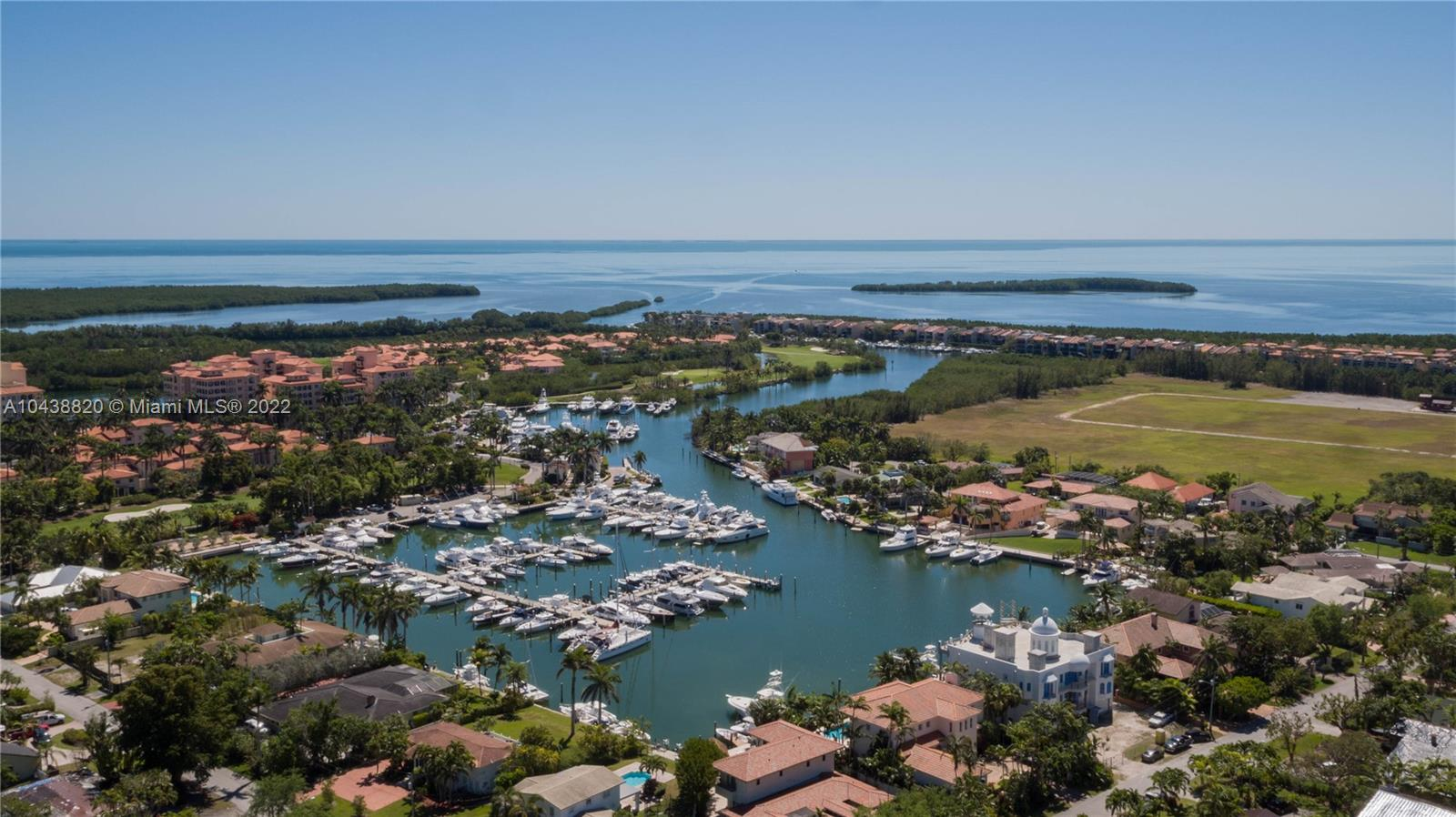 Just minutes to the bay from a private dock - rarely available gorgeous waterfront home with stunning Wide Views of the Deering Bay Marina and deep water lagoon - 100' sea wall accommodates five 50' boats - no bridges to bay or ocean. Located in prestigious Coral Gables gated community of Kings Bay Estates. Features striking interior spaces, several balconies, formal dining, gourmet kitchen with cooking island, soaring ceilings, over-sized rooms, sweeping staircase, first level is a 3300 SF garage for 8 plus exotic or otherwise personal vehicles, elevator from garage to upper level interiors, and a 24/7 recorded nine camera security system . Incredible for ardent car and boat enthusiast.