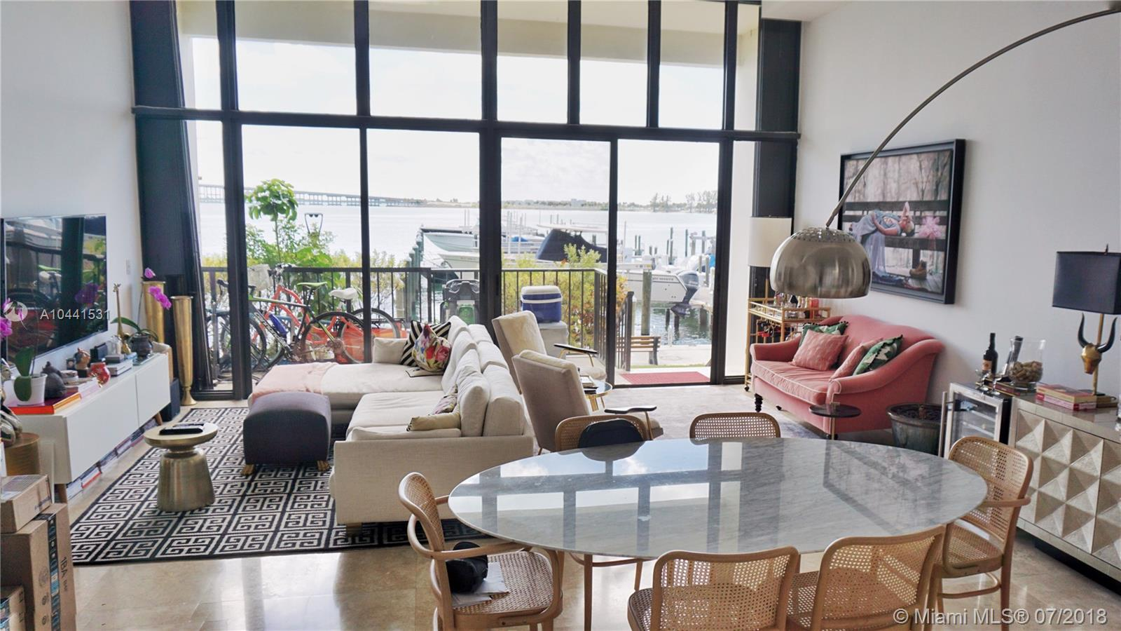 Beautiful and unique townhouse with amazing Biscayne Bay views. Recently completely remodeled with all modern upgrades one would expect. Master bedroom has walk-in closet and steam room shower. Floor to ceiling windows everywhere. Direct and private access. Two private parking spaces. It's like living in a home but with all the condominium amenities. Can be sold furnished or unfurnished.