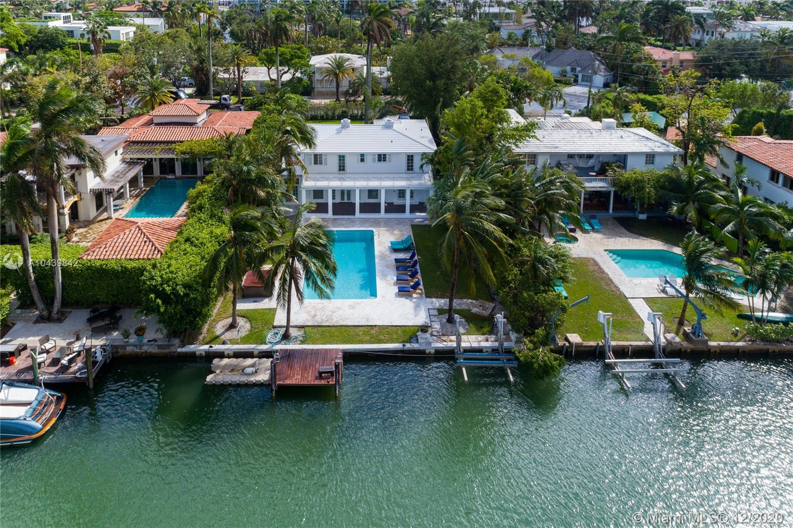 Newly updated Charmer on Gated Sunset Island 4. This is a 5 bed 4 bath home with an additional den that could be used as office/gym. Large terrace off Master upstairs and large covered terrace leading to an oversized pool. Dock, boat lift, and floating jet ski dock along 75' of waterfrontage. Garage and maids quarters. Home has been extensively renovated to include new Kitchen cabinets, new bathrooms, and freshly painted inside-out. Quiet street, close to Lincoln Road and Sunset Harbor shops and restaurants. Location allows you to experience a true South Beach lifestyle.
