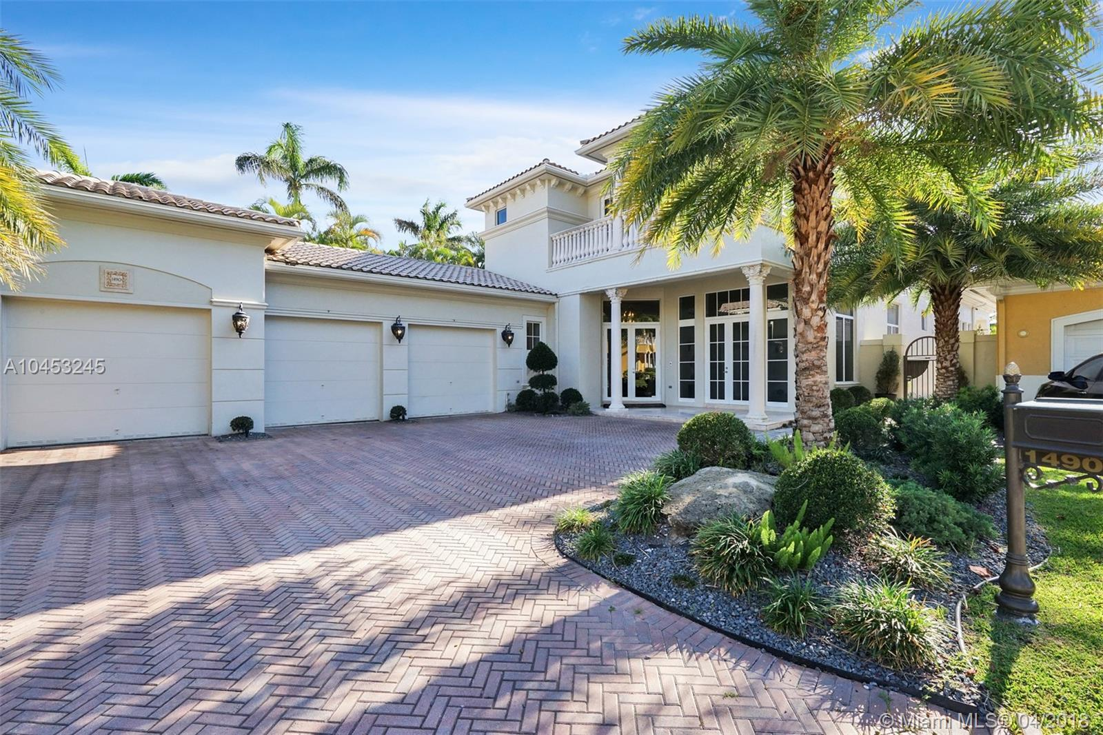 LOCATED IN THE PROMINENT COMMUNITY OF HARBOR ISLANDS, THIS UNIQUE MEDITERRANEAN RESIDENCE, BOASTS (5) BEDROOMS, (6 & ½) BATHROOMS, AND AN OFFICE SPACE. SETTLED ON A CUL-DE-SAC (A QUARTER ACRE LOT) WITHIN THE EXCLUSIVE SECTION OF COMMODORE ESTATES ALSO FEATURES AN EXTENDED AND PROTECTED DEEP WATER DOCK BEHIND A MARINA WITH ROOM FOR A 60+ FOOT YACHT ACCESSIBLE TO THE INTRACOASTAL WITH ADAPTABLE  BRIDGES FOR CONVENIENCE. THIS IMMACULATE PROPERTY FEATURES A LIVING ROOM WITH SPECTACULAR 22 FOOT CATHEDRAL WINDOWS, NATURAL LIGHTING, AN AUTHENTIC STONE FIREPLACE, IMPACT GLASS THROUGHOUT WITH TRIPLE CROWN MOLDINGS. WITH BEAUTIFUL MARBLE INLAYS SOURCED FROM SATURNIA, TUSCANY AND DARK CHERRY WOOD FLOORING IN EVERY ROOM. EQUIPPED WITH PREMIUM VIKING PROFESSIONAL CHEF APPLIANCES.