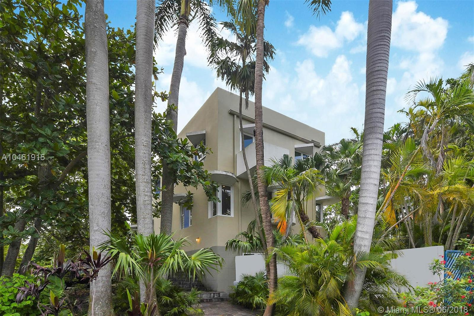 This energetic work of art is located in the prestigious gated community, Entrada Estates in Coconut Grove. Completely updated including top of line appliances, custom solid wood cabinetry and vanities and wood flooring. The three-story façade captures Florida's architectural legacy drawing on everything from the work of contemporary Miccosukee Indian craftsmen to indigenous folk art. This private waterfront community shares inlet w/ docks & clay tennis court conveniently located steps from the property.Two car garage w/ storage & room for a pool. Originally designed as Arquitectonica'sfamily home this is a must see if you are currently looking to buy in a gated oceanfront neighborhood w/ 24/7 security guard.A short stroll to the Grove's shops, restaurants, best schools and activities.