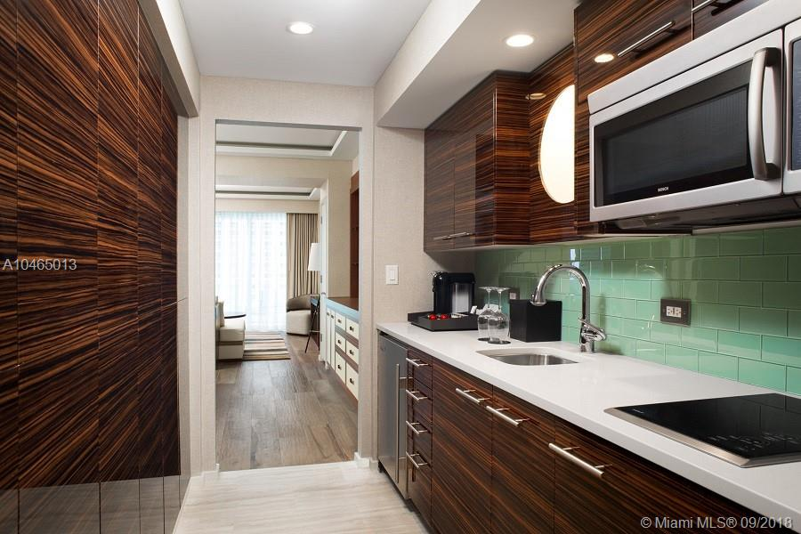 Luxurious Resort Residences, presented as hotel/condos, professionally designed & fully furnished by Steven G. This poolside unit features a lanai, marble bathrooms with double sinks, marble tub & separate walk in shower. Kitchen has a Wolf range and Subzero appliances. Luxury resort amenities, including twice per day housekeeping, laundry service, beach service, pool service, gym, house car service, Conrad spa, 24 hr valet parking and more. Hilton Gold Membership. New Construction, now open, close immediately.
