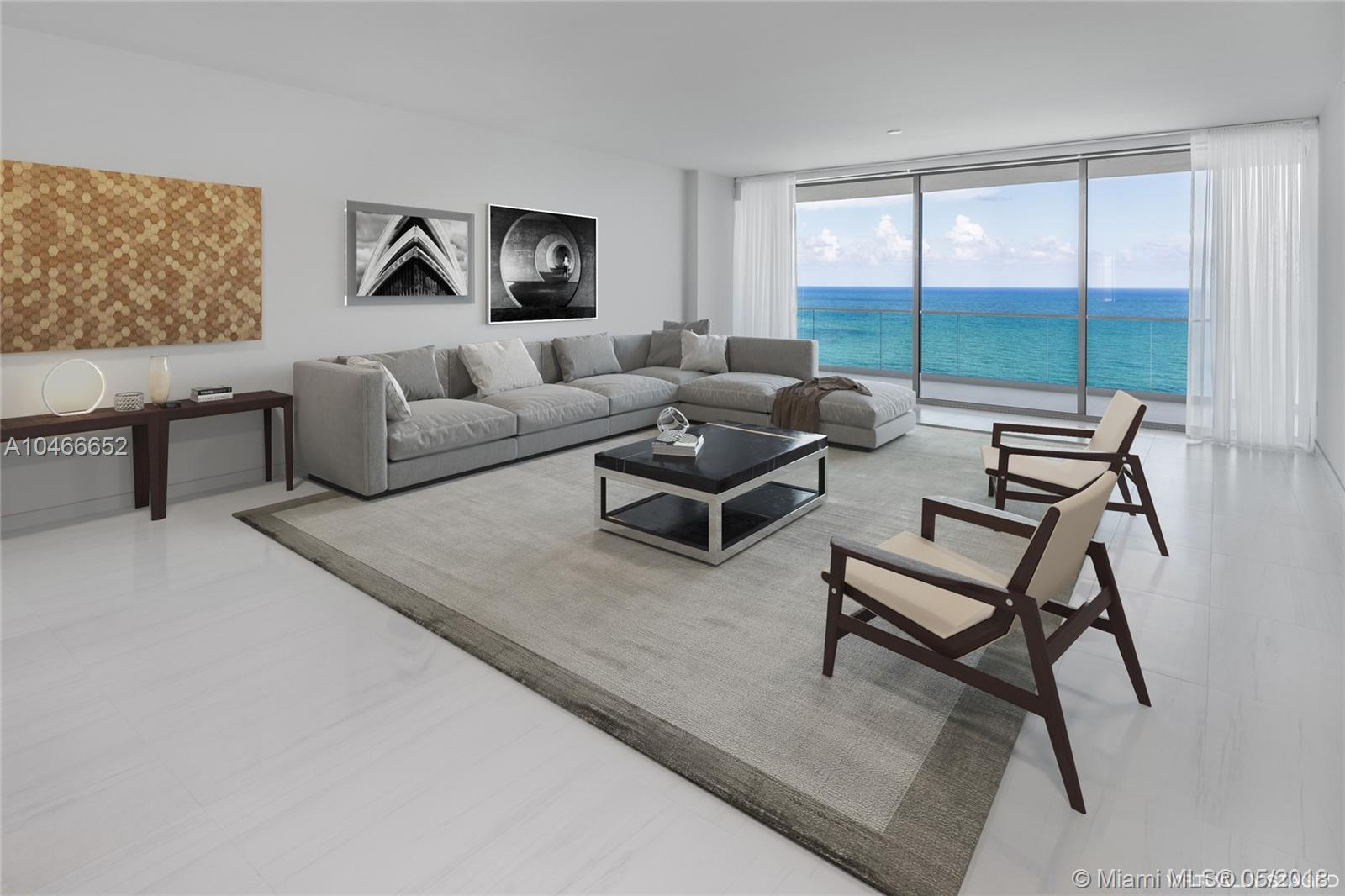 Be the first to live in the spectacular flow through unit with breathtaking ocean and city views! The unit offers 3,592 sqft, 3 bedrooms, 4 bathrooms, separate maids quarters and 745 sqft of terrace. Top of the line Gaggenau appliances, window treatments, and white Calacatta marble thought out the apartment. This is an unparalleled and stunning oceanfront high rise in a five star residence with resort-style amenities. Amenities included: 24 hour concierge, poolside restaurant under Starr catering, tennis courts and world-class spa. You don't want to miss this!