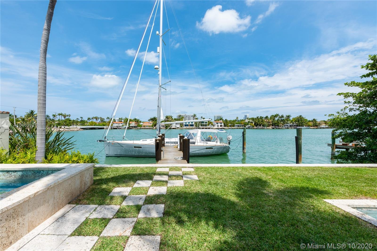 Beautiful Mediterranean-style waterfront on the Venetian Islands in Miami Beach. Detailed with arched doorways, high ceilings, wood-burning fireplace, and large windows among many other are the glass-enclosed living room with a built-in entertainment bar, the family room, and the formal dining. The first floor is completed with an office with a powder room, a staff room, and an eat-in kitchen with a breakfast bar. Four bedrooms upstairs, including a master suite with 2 walk-in closets and beautifully renovated mosaic tile bath. Step outside to find yourself surrounded with lush vegetation, the scent of blossoming flowers, and a sight of the water. The backyard features a large pool, a spa, full cabana bath, a gazebo with a summer kitchen, and an observation deck.