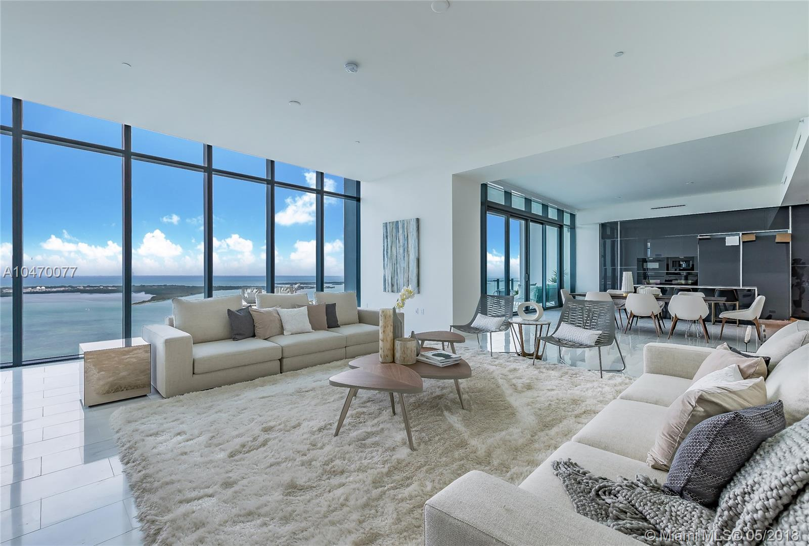 Stunning Designer appointed turnkey Lower Penthouse residence with incredible unobstructed  views of Biscayne Bay, Miami skyline, and the Ocean - with East, West, North & South views.  Fully furnished & ready to show to your most discriminating Buyers,  Featuring a spectacular Master Suite, with built-in Italian closets & extra tall floor to ceiling windows.  Marble flooring throughout, 7-foot Italian entry doors, and Poliform kitchen cabinets.  Echo Brickell is a state of the art Smart building, designed by Carlos Ott + Yoo, 4000 sq ft fitness center, Infinity edge pools. Enjoy complimentary daily breakfast poolside, in-house chauffeur services, or the on call dog walkers.  Best Penthouse opportunity in all of Downtown Miami.