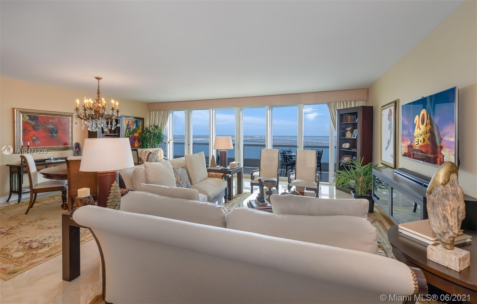 "SPECTACULAR RESIDENCE ON DESIRABLE ""03 LINE"" SHOWCASING: A TOTAL BAYFRONT EXPOSURE, 2 BEDROOMS AND 2.5 BATHROOMS, 2,180 SQFT OF LIVING AREA, PRIVATE ELEVATOR & FOYER, GLASS TO CEILING WINDOWS,