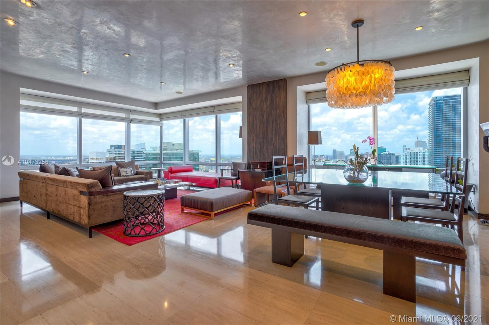 Motivated Seller, make an offer!!! Four Seasons Residences. Most spectacular and up-scale building in Brickell. Located walking distance to fine dinning, shops and night life. This beautiful unit offers Top of the Line finishes, amazing 260 degrees views and outstanding amenities, 3 pools W/Cabanas, room service, 24 hr Concierge, Security, Valet, Restaurants, 4 free memberships to Equinox Fitness Club.