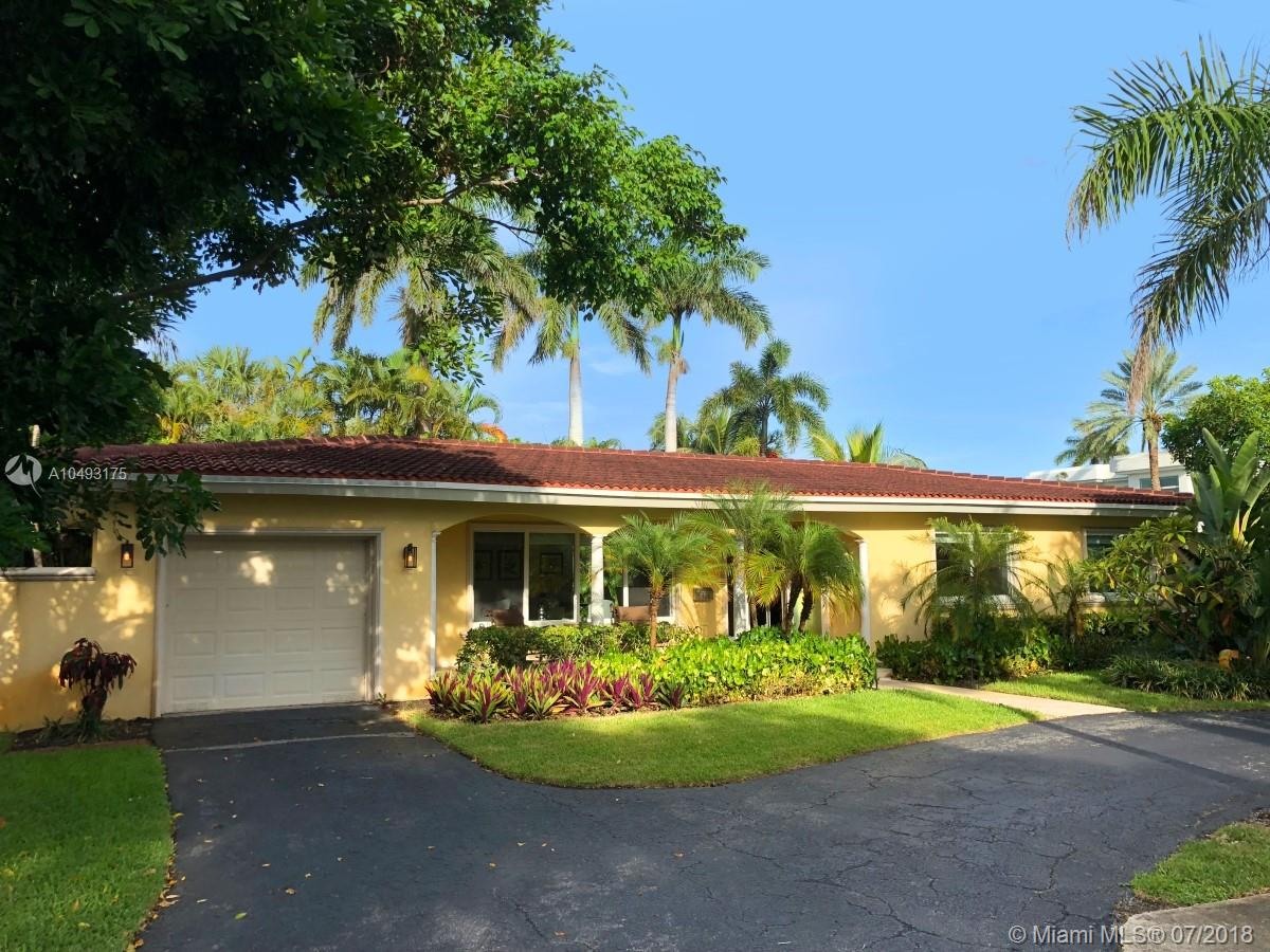 Coral Ridge Jewel Box completely renovated. Surrounded by multi-million dollar homes, and prestigious Bayview Elementary School, this corner lot property has it all. The 9050 sq ft lot is walled and fully private. The pool, spa, and rock waterfall, is heated and large, with shallow shelf for kids, but still leaves large areas of lawn. The house has real Brazilian Cherry hardwood floors throughout which glisten with warmth. The kitchen has all new cherry cabinets and top of the line stainless steel appliances. The house has impact windows and doors throughout. The Master Bedroom opens thru french doors to the pool, and is complemented by a fantastic bathroom with separate tub and shower and slab and tumbled marble. This home has large open living space and filled with light. Wont last long.