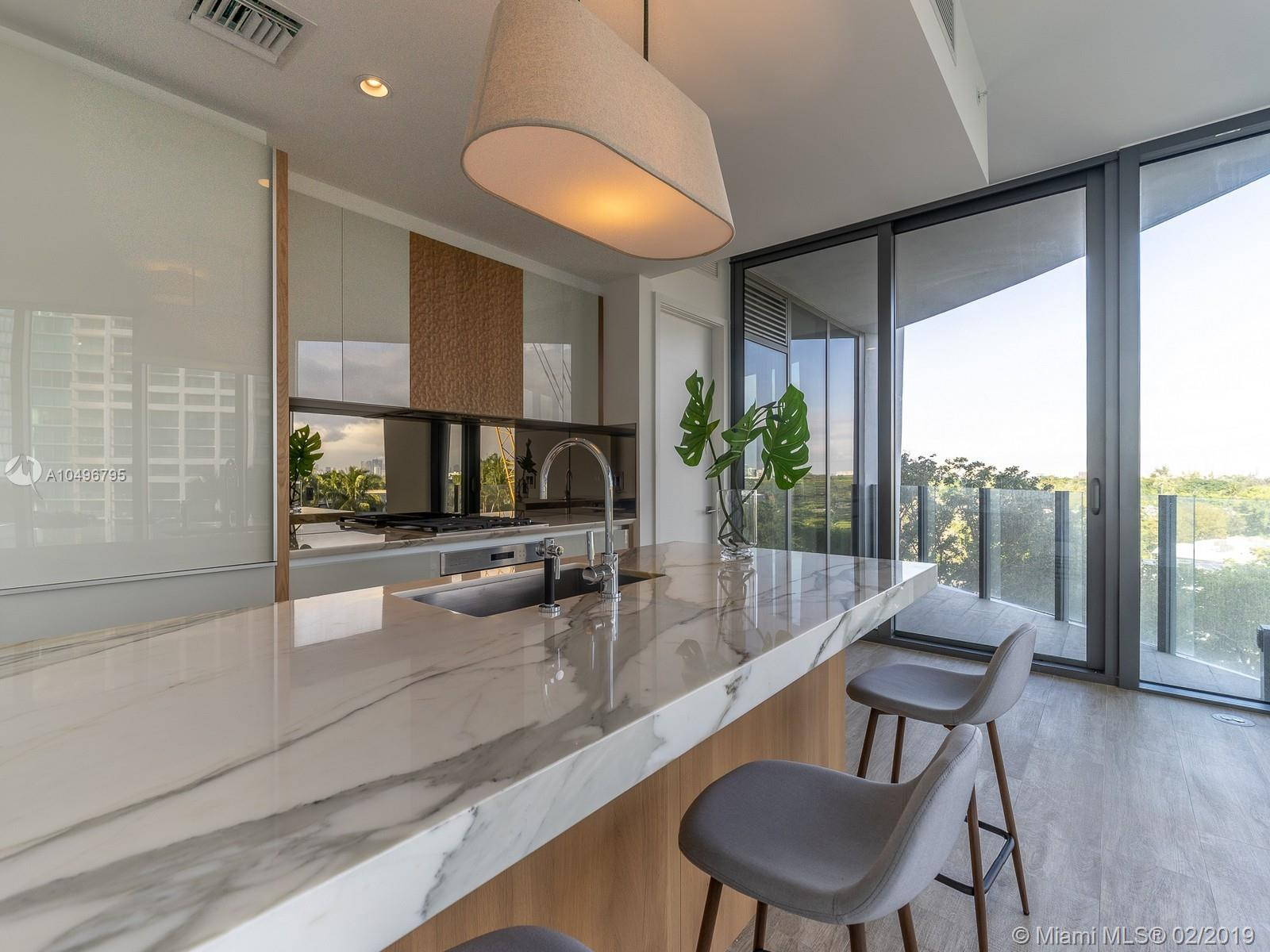 Spectacular 2/2 plus den unit with top of the line appliances and high ceilings combined with contemporary finishes in the most expected Grove Development, Park Grove Residences,  emphasizes luxury living and first class amenities in a very tranquil design environment that provide residents with a unique Experience. Newly Built and Designed by Pritzker Price winning architect Rem Koolhaas/OMA and landscape designer Enzo Enea, Park Grove is definitely Grove luxury living at its Best.