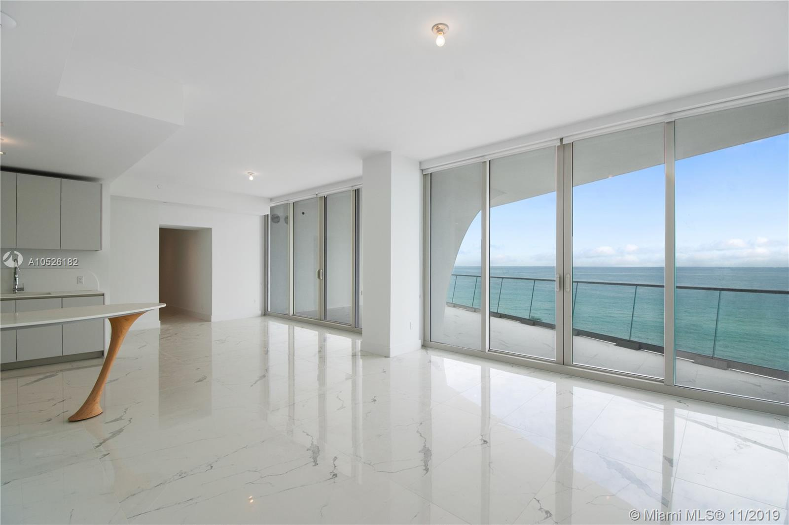 """BRAND NEW IN SUNNY ISLES BEACHFRONT ''JADE SIGNATURE"""" DESIGNED BY PRITZKER PRICE WINNER ARCHITECTS HERZOG AND DE MEURON. THE INTERIORS HAVE BEEN DESIGNED BY THE WORLD RENOWNED PIERRE IVES ROCHON. THIS PREMIER LINE BOASTS UNOBSTRUCTED OCEAN VIEWS & A HUGE OCEANFRONT TERRACE. THE FLOW THRU PLAN ALSO OFFERS CITY LIGHTS + ALTERNATE VIEWS. THIS SPECTACULAR RESIDENCE HAS WHITE MARBLE FLOORS + CUSTOM SHADES THRU-OUT + FLOOR TO CEILING WINDOWS + SOUGHT AFTER FLOOR PLAN 2 BED 2.5 BATH & STATE OF THE ART OPEN KITCHEN + LARGE GREAT ROOM. MOTIVATED SELLER! 3 FULL FLOORS OF COMMON AREAS W/ PIECES FROM HERMES, KAGAN, KNOLL, ROCHON, ETC. AMENITIES INCLUDE: BREAKFAST CAFE, BUSINESS CENTER, , BEACH BAR & GRILL, TATA HARPER SPA W/ STEAM, HAMMAN, SALON & WATER THERAPY TERRACE. PILATE'S STUDIO."""