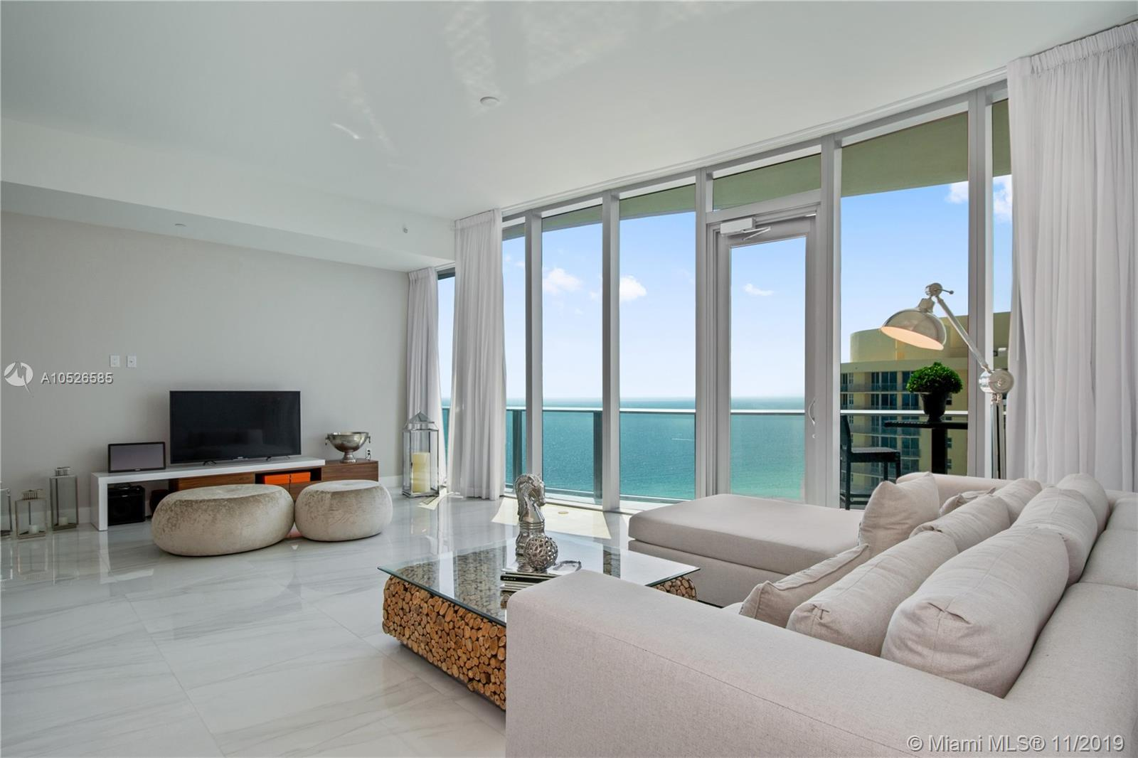 BRAND NEW Chateau Beach Contemporary Dream, Furnished to perfection- A Luxurious Beachfront Building w/ Captivating Direct Ocean + Miami Skyline Views. East + Southeast Views Cannot Be Blocked by Any Future Building!  Large 2 Bed/ 3 Bath + a Den or 3rd bedroom with full bathroom, State of the Art Open Kitchen, White Marble Floors Throughout, Huge Private Balcony that Feels Like It's Right Out On The Crystal Blue Water! High Ceilings Throughout, Both Bedrooms w/ Stunning Marble Baths. Spectacular New Residence Is A Dream! - Show + Sell! A quiet, elegant, exclusive building offering luxury & lifestyle w/ 5 Star Amenities incl. a relaxation terrace w/ aromatherapy jacuzzi, Beach & Pool service, Cigar Room, Home Theater, Wine Lounge, Concierge, and much more!