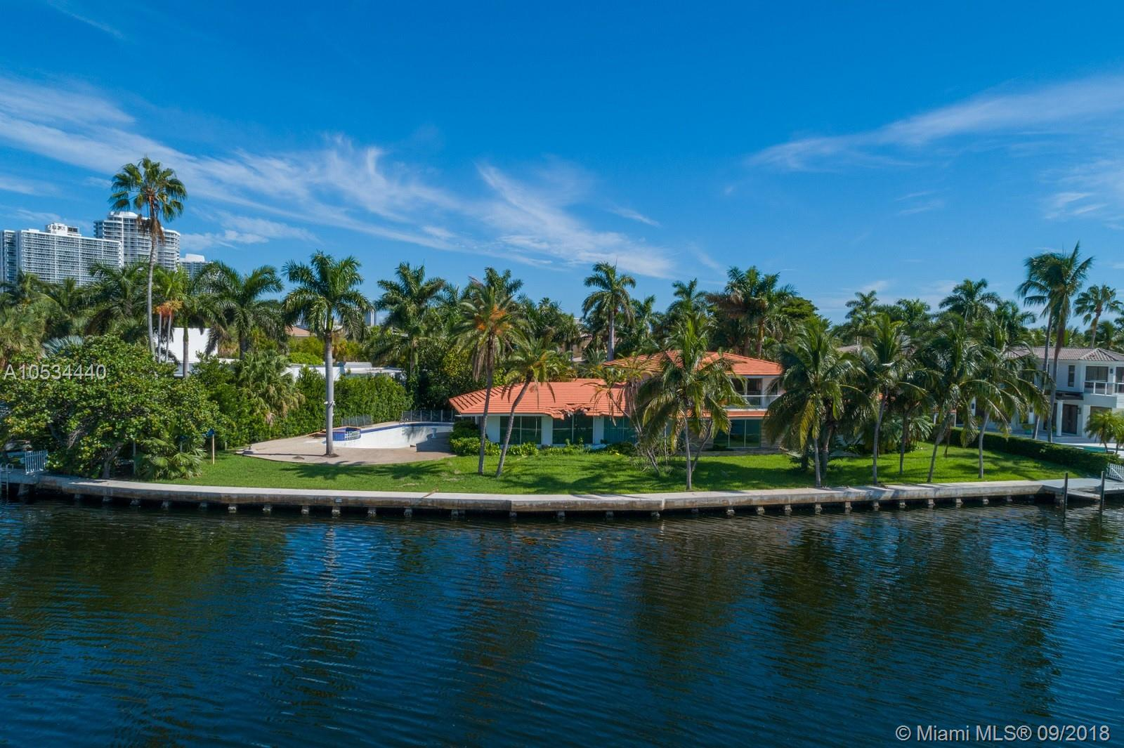 The Most Magnificent Intracoastal Property in all of Golden Beach. Situated on a Point cul-de-sac Lot with exquisite Mesmerizing Views, straight to Downtown, Miami and breathtaking Sunsets. Almost 200 ft. of Water Frontage!