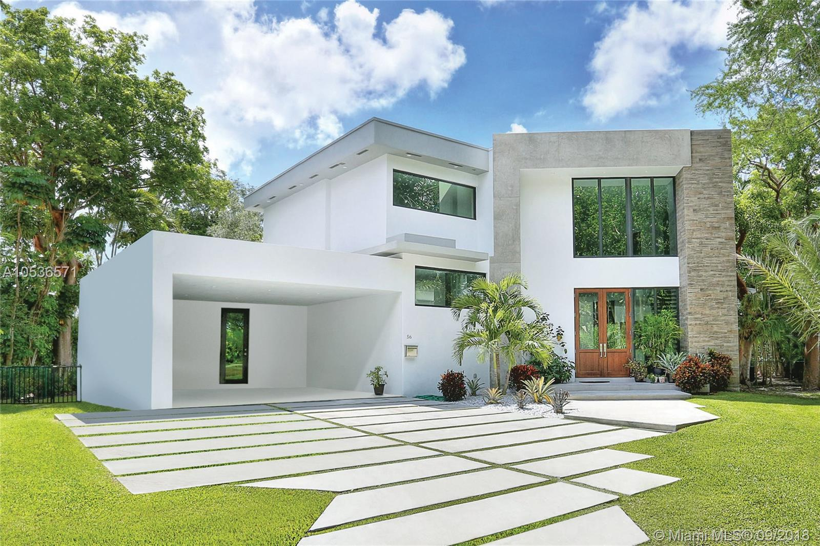 Brand new tropical modern custom house with incredible design features that are full of warmth and design savvy. Located in sought after Bay Heights, enjoy the security of 24-hour Miami police patrol and costs already included in taxes. Spectacular supersized open social areas with tall ceilings and long walls of glass perfect for the art collector and design enthusiast. Custom cabinetry throughout with 48x48 marble and porcelain floors. All en-suite bathrooms, and the master features a special spa like aesthetic. Beautiful outdoor spaces to enjoy your own personal paradise. All concrete construction. Not located in a flood zone. Come and be dazzled!