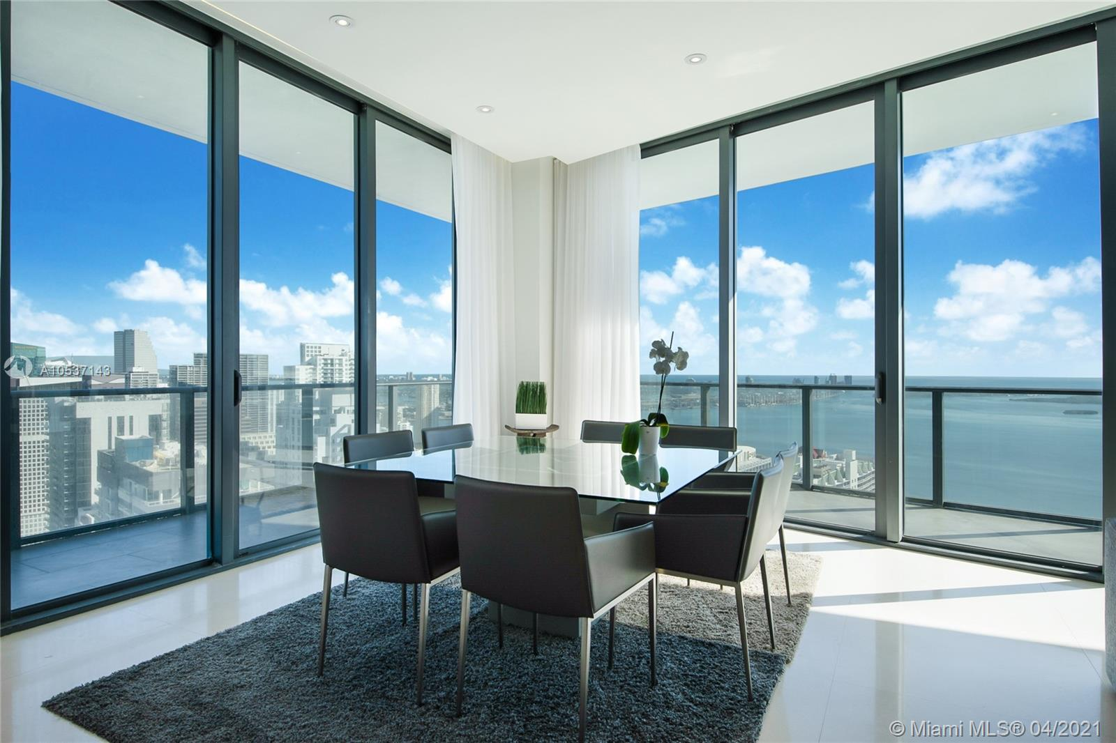 NEW GREAT PRICE AND PRICED TO SELL. AMAZING SLS BRICKELL PENTHOUSE WITH THE BEST UPGRADES IN THE BUILDING. TILES ARE MOCHA CREAM LIMESTONE FROM PORTUGAL. THE DOORS ARE ITALIAN STYLE, FRAMELESS WITH ITALIAN MAGNETIC DOOR HARDWARE. THE MASTER CLOSET HAS AN ITALIAN STYLE WOOD VEENER CLOSET AND THE MASTER BATH HAS PORCELAIN TILES FROM SPAIN TOGETHER WITH AN INFINITY ELECTRIC MIRROR. THE UNIT HAS LED SPOTLIGHT LIGHTING THROUGHOUT. EACH OF THE 3 BEDROOMS HAS MOTORIZED BLACKOUT SHADES. 