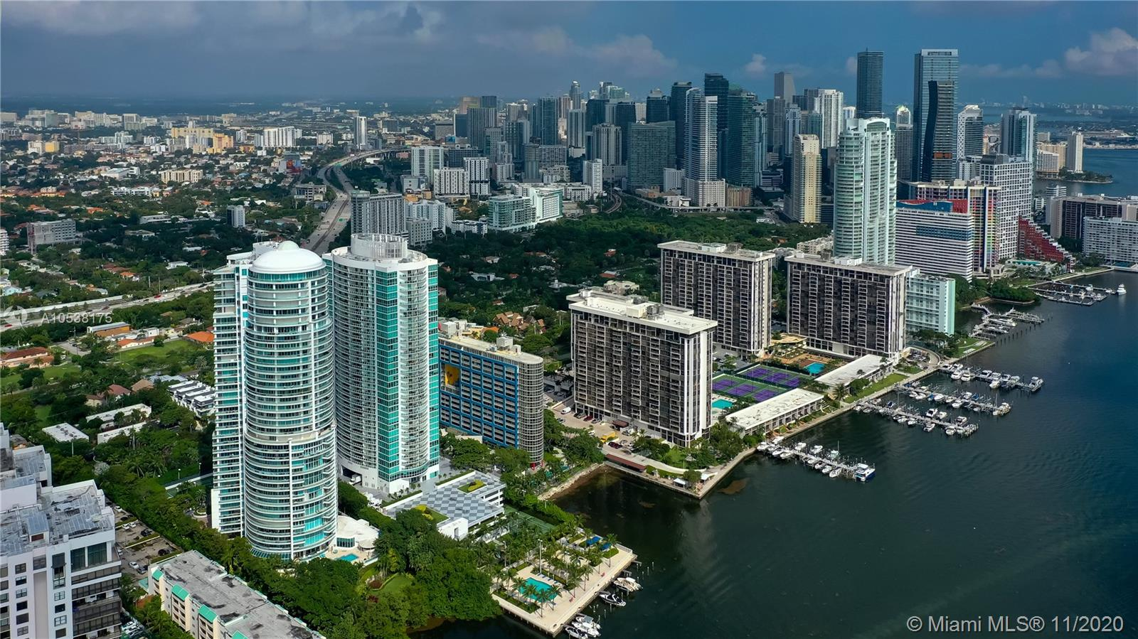 SPECTACULAR 3 BEDROOMS PLUS OFFICE PLUS DEN AND 3 FULL BATHROOMS. CONDO COMPLETLY REMODELED BY ARCHITECT FIRM BA DESIGN.  MARBLE FLOORS IN LIVING AREAS AND WOOD FLOORS IN BEDROOMS.  INCREDIBLE 180 DEGREES VIEW  TO BISCAYNE BAY AND CORAL GABLES.  WRAP AROUND BALCONY WITH MAGNIFICENT VIEWS FROM EVERY ROOM.  3 PARKING SPACES.