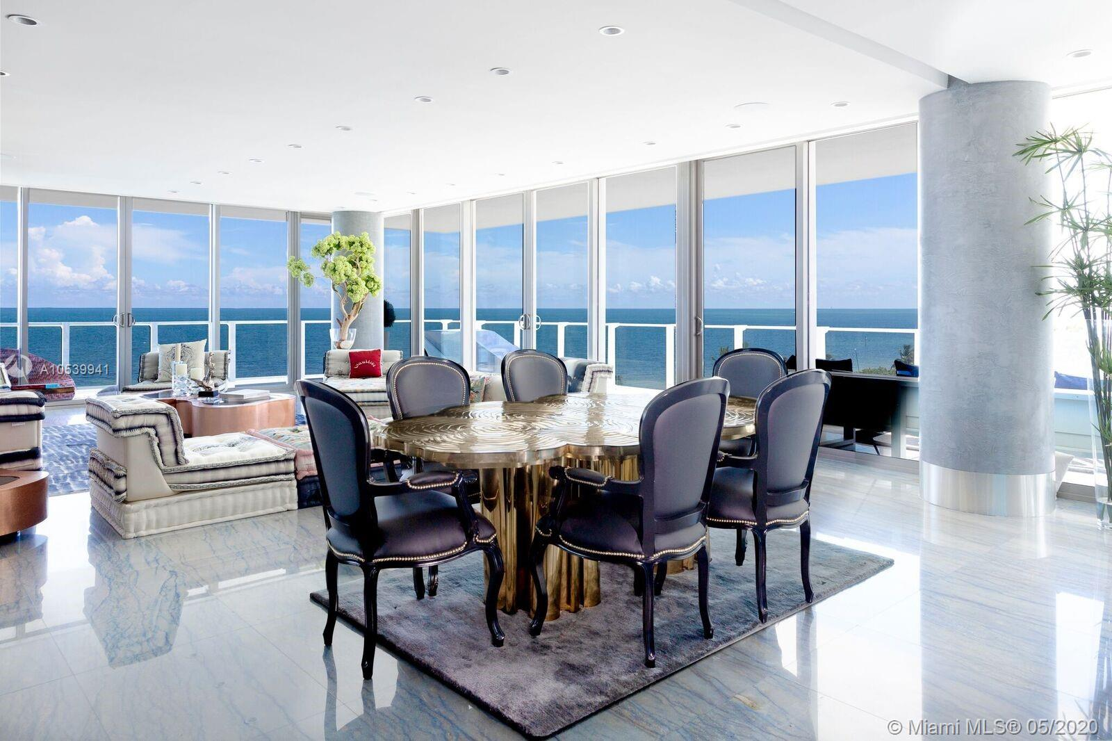 One of its kind corner unit with views of Ocean, Bay,City Skyline, Sunrise & Sunset. 4,080sf under AC (4 units). Flow-through corner unit w/ 2000sf wrap-around terrace. 4BED+7.5BATH + maids quarters. Master Bath His & Hers marble thru-out with stainless steel bathtub with views of the ocean. Finished floors with top of the line Italian Marble. Finished to perfection! Exclusive Boutique Resort Lifestyle with Spa facilities, Fitness center, lap pool, Infinity pool with Restaurant,Tennis clay court, Putting green, kids room, tv room and party room with kitchen facilities. 24hrs. concierge, gated security, valet. Definitely the Best building in KB. I could describe this corner unit as your glass mansion on the ocean in paradise !
