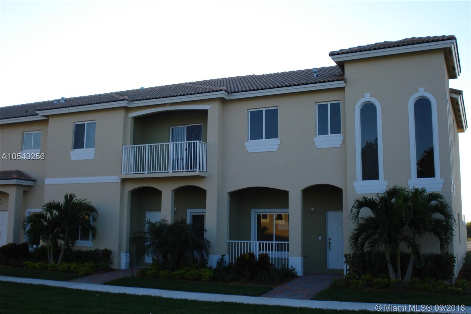 beautiful 3 bedroom 2.5 bath corner townhome with 1 car garage in desirable gated community of Cali Greens at Keys Gate.  This unit was a former model and features granite counters with tiled back-splash in the kitchen, first floor 18 X 18 tile and carpet upstairs, impact glass windows through-out, a large pavered courtyard perfect for entertaining and much more.  Owner is requiring 1st month's rent and double security, full credit reports and proof of income. Hurry won't last long!