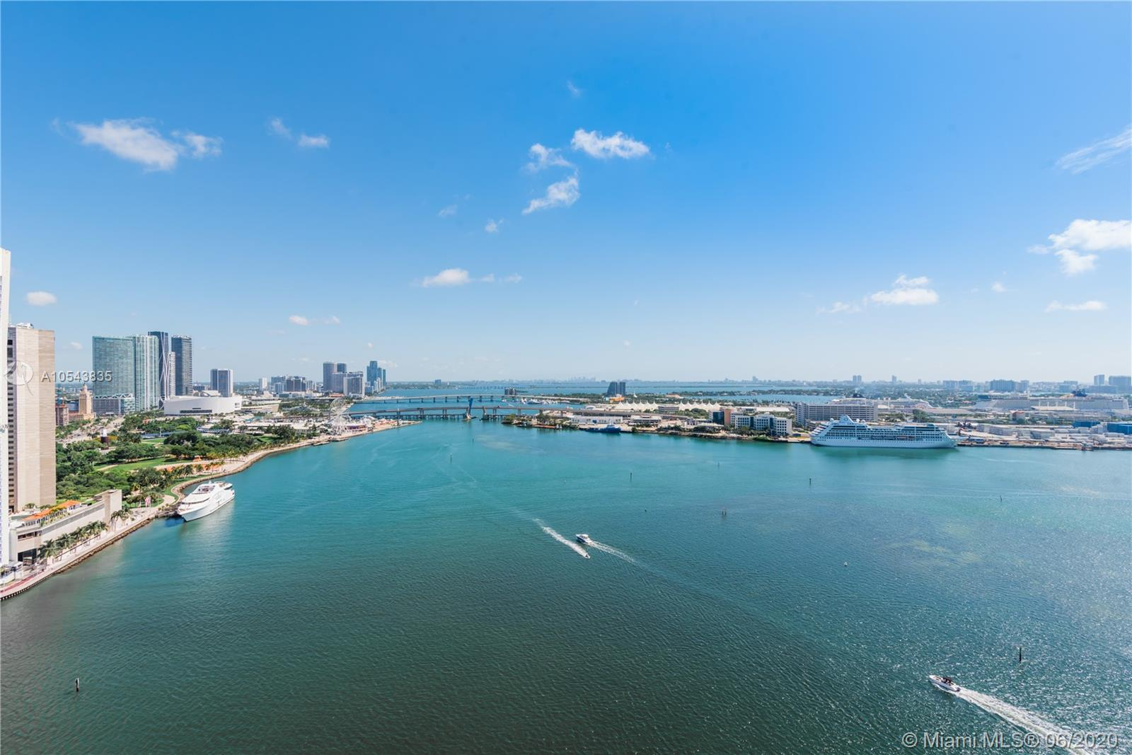 Espectacular corner unit with breath-taking water views overlooking the port of miami, miami beach, key biscayne and the bay, 3 bedrooms and 2 and half bathroom, marble floors thought-out, and porcelain wood floors on the bedrooms area, custom made closets, italian kitchen, granite counter-top, stain steal appliances, wall covering, very bright unit and very spacious... first time on the market