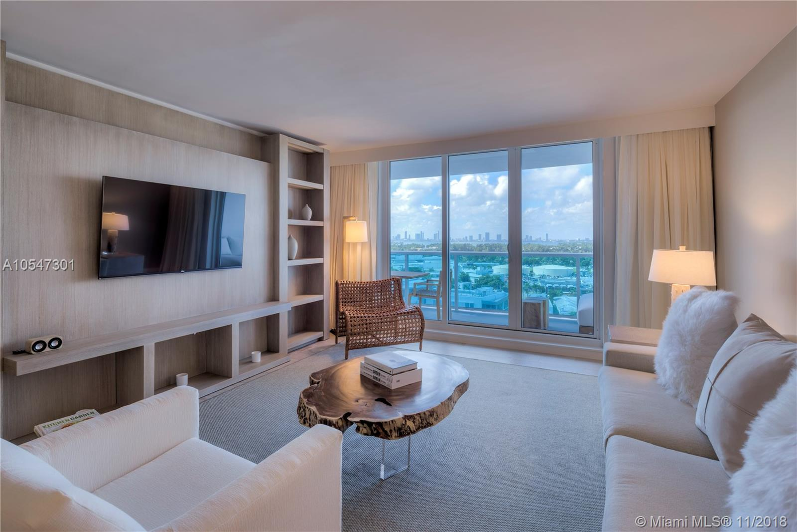 Gorgeous 2 bedroom skyline view luxury 1,239 Sq. Ft. condo rents between 30% - 60% below hotel rates. Why pay more if you don't have to? Luxurious linens and towels, Gilchrist and Soames toiletries, and daily coffee and tea. Residence comes with a fully furnished private balcony with views of the Miami Skyline. Custom Italian and Brazilian furniture package provided by hotel. Plush living room sofa that converts into a queen bed, ItalKraft kitchen with stainless steel Bosch & Subzero appliances and a 4 seat dining table. Our guests have access to all of the hotel amenities including 4 swimming pools, 4 restaurants, beach service, cabanas, fitness center, spa, valet service, concierge, ballroom, conference rooms and more.