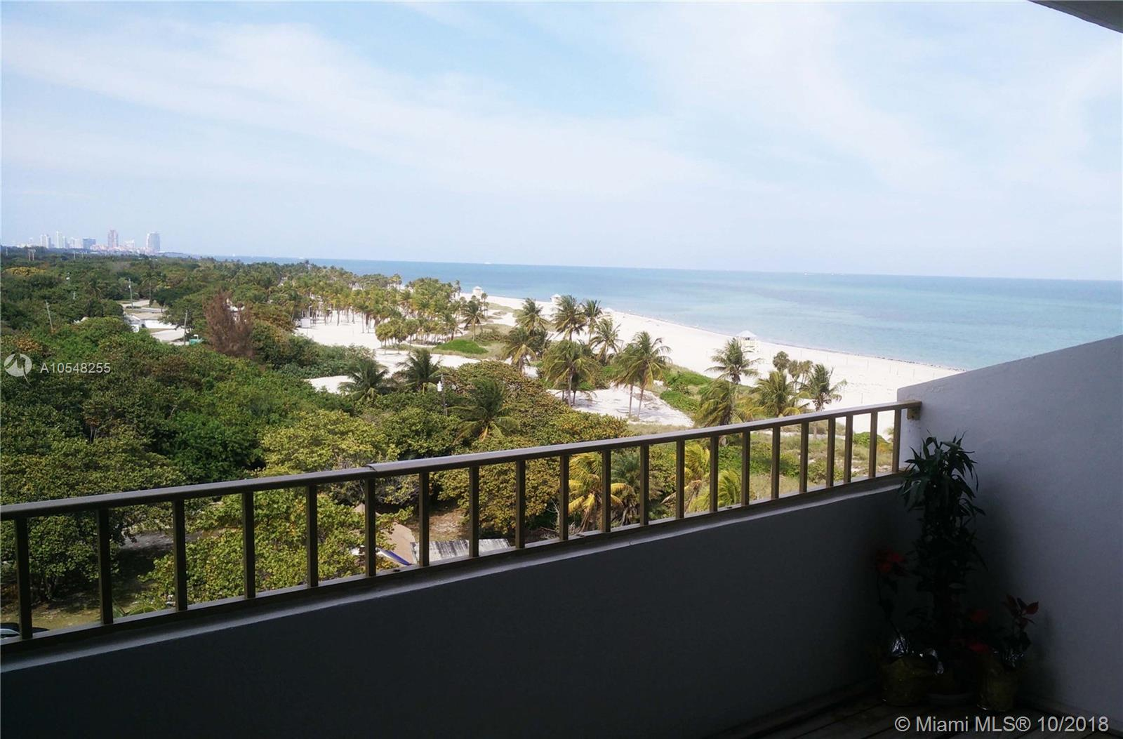 No one will ever take away the unobstructed view of the ocean, Downtown, South Beach and Crandon Park of this apartment! Beautifully updated one bedroom 1.5 bathrooms residence with lots of light, open kitchen, washer and dryer in unit, wood and seagrass floor. Covered assigned parking and direct private beach access. Building amenities include tennis court, gym, sauna and recreation room. Replacement of living room sliding door and bedroom window with impact glasses is in progress and included in asking price: a $ 18K value!Unit is leased; please give 24 h notice minimum for showings.